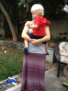 My friend Amber carrying her cute toddler on her hip. Much better.
