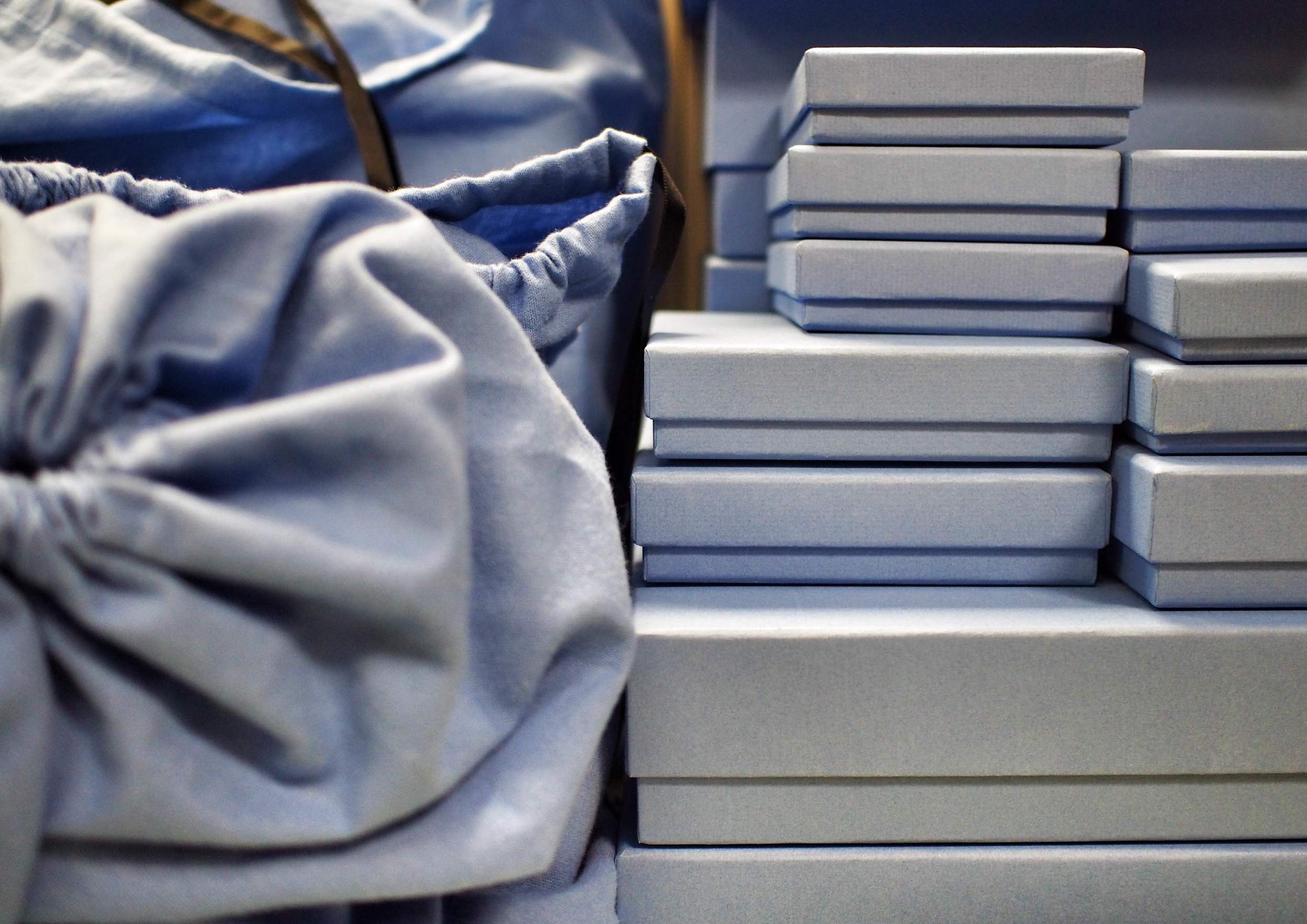 Stacks of Nile Blue boxes
