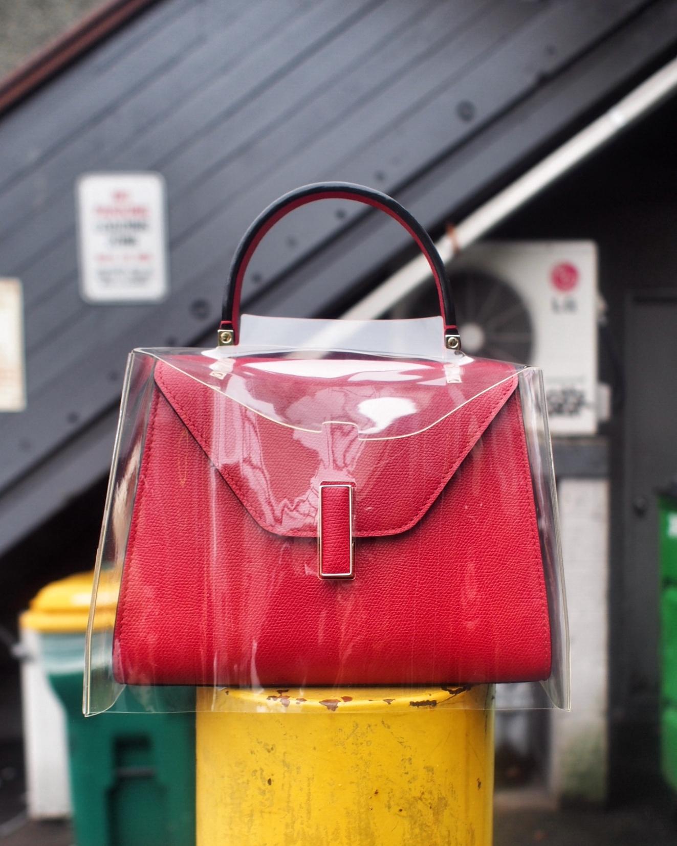 """Mini Isida bag and """"raincoat"""" in store."""