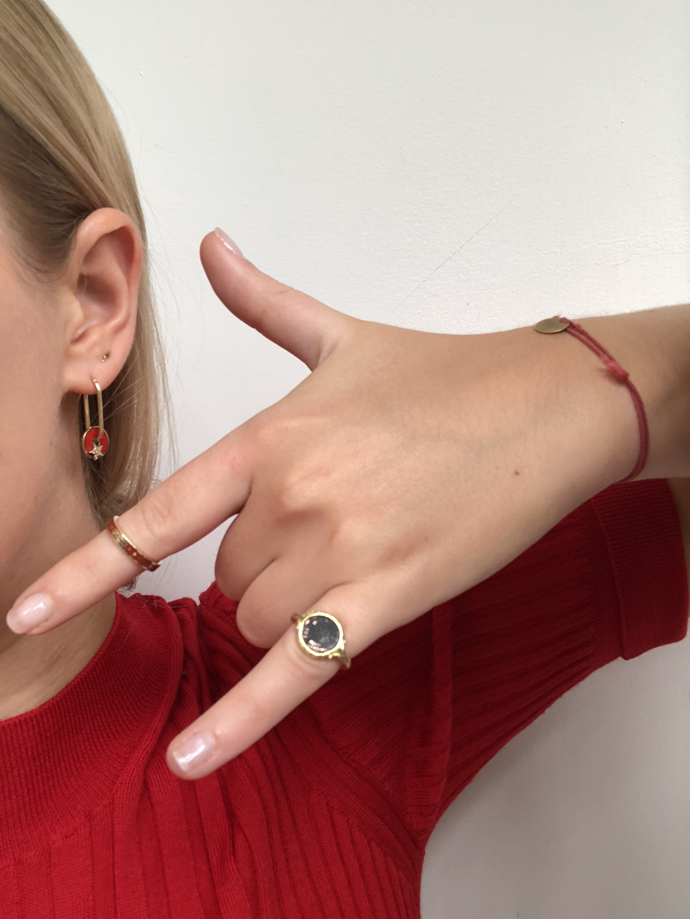 "Favorite Item #1 - Elizabeth wears her Foundraw disc earring everyday (and her ratty Merci string bracelet). The Foundrae ""fuerza"" ring is her favorite thing in the whole store."