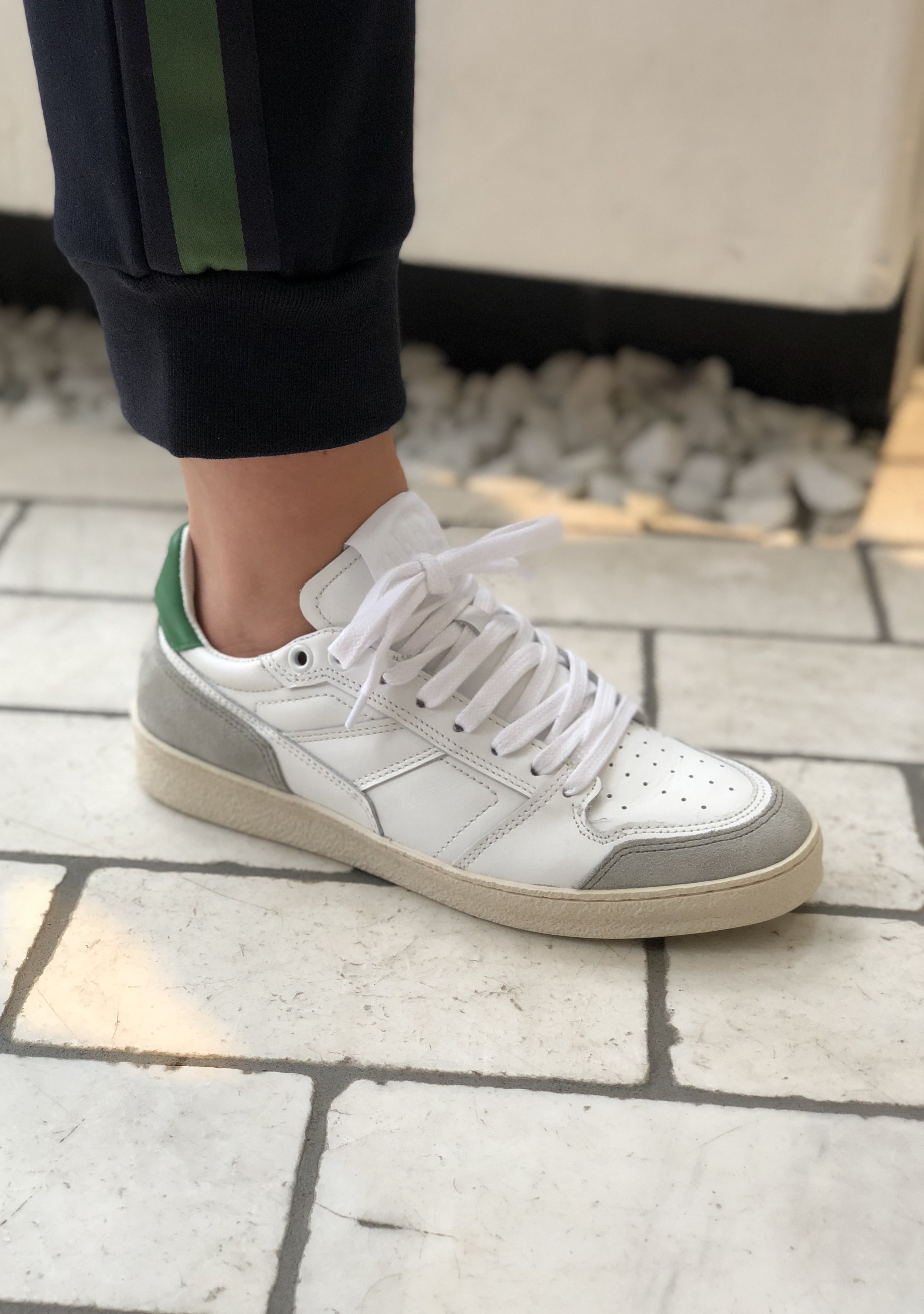 Favorite Item #1 - Claire says these are the perfect white sneaker. Super comfortable, but a little different. Plus we love Ami in general as well as designer Alexandre Mattiussi.