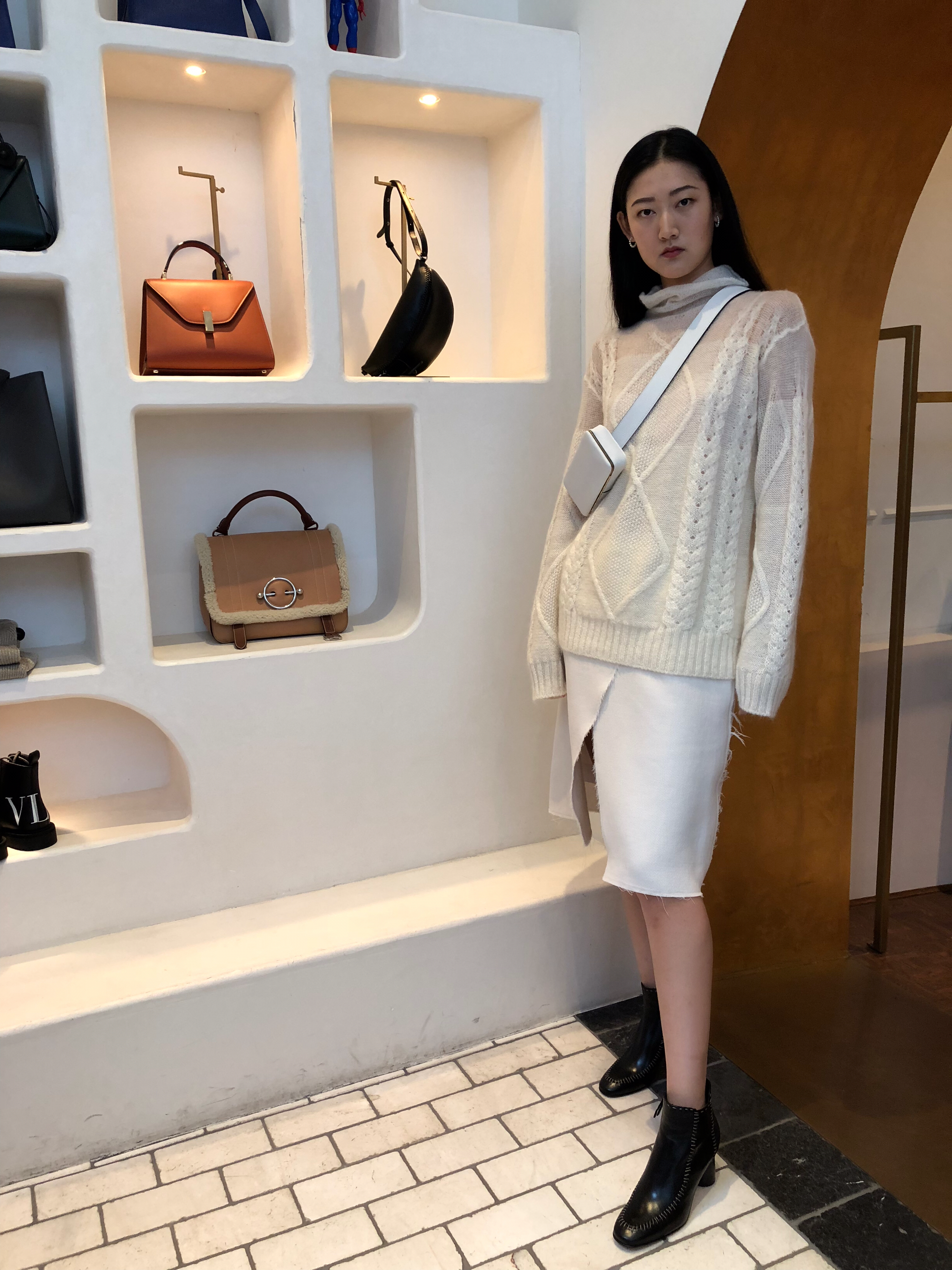 It's a total white-out in Outfit #1. Sihan wears Maison Margiela Sweater and skirt with boots by JW Anderson.