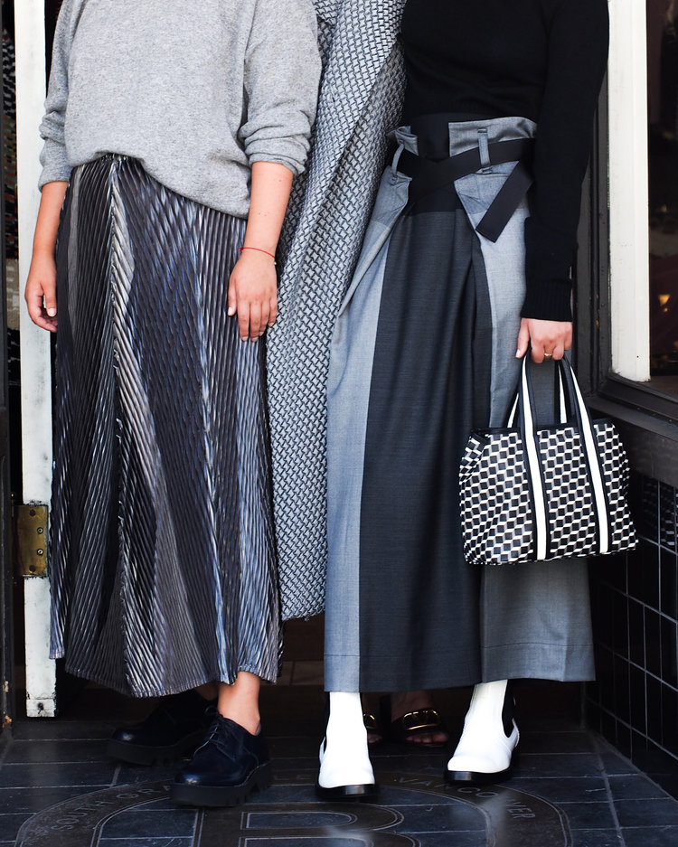 Issey Miyake skirts and coat. Sofie D'hoore oxfords and Pierre Hardy boots and bag.