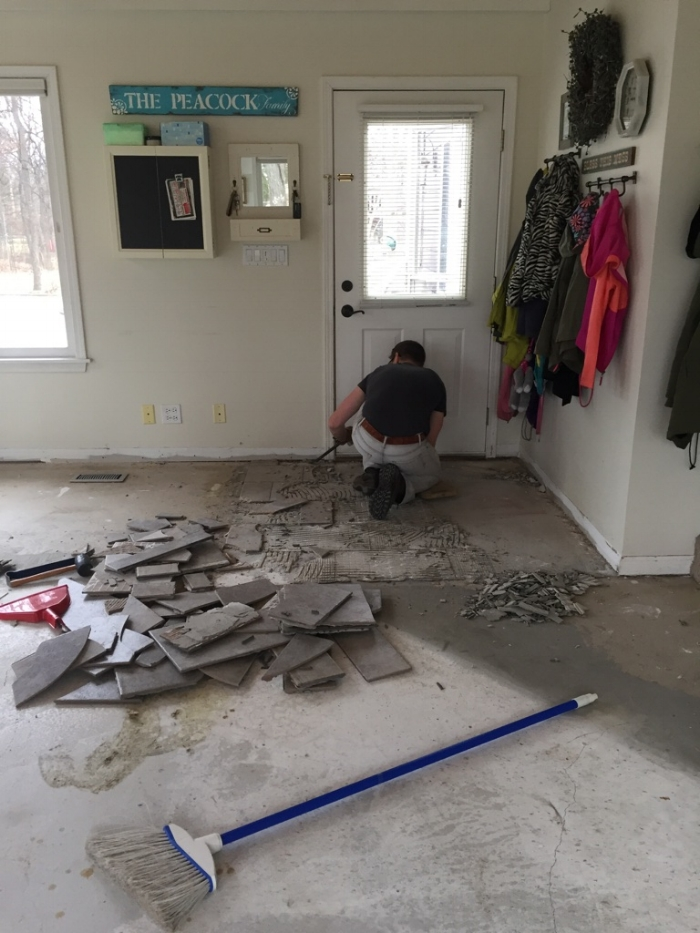 Tearing out flooring.