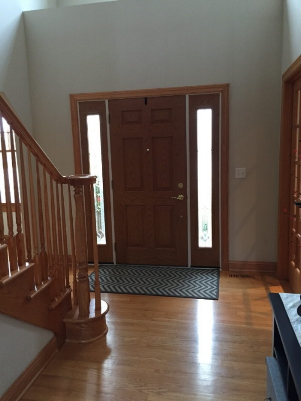 The door will be painted and the door trim beefed up, along with refinishing of floors and staircase.