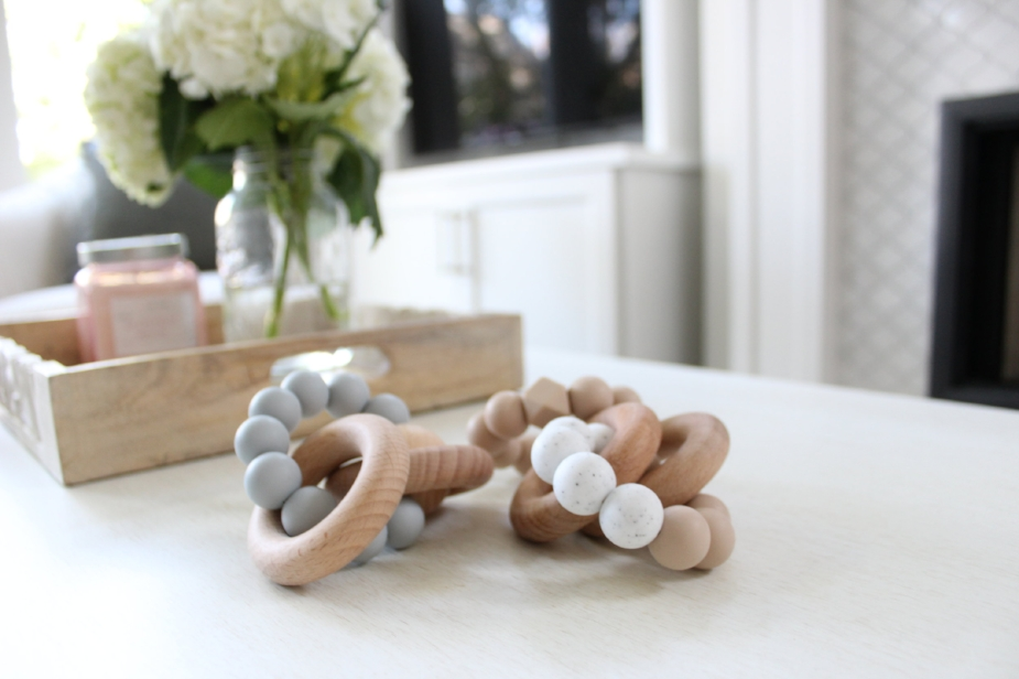 Hipster kid-proof coffee table styling accessories: Teething rings that look like glass beads