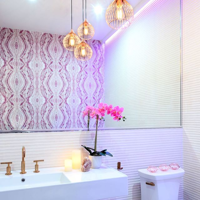 ...And let's not forget the oh so important restroom, clientele can always tell a lot about a space by the detail and thought that's put into the secondary spaces.  The restrooms are one of our favorite places to get the most creative! We love to juxtapose very different textures, patterns and finishes; for example this gorgeous @eykondesign selenite #sourceonewallcovering that started it all, complimented by the beautifully textured @porcelanosa wall tile which we extended by reflecting in a large scale mirror and finished off with metallic rose gold @kohler purist line fixtures and a fun @elegantlighting multi-pendant.  Photo cred: @haphotography.nyc #whybeordinary #restroomdesign #bathroomdesign #mixingmaterialsandpattern #prettywallpaper #texturaltiles #rosegoldfixtures