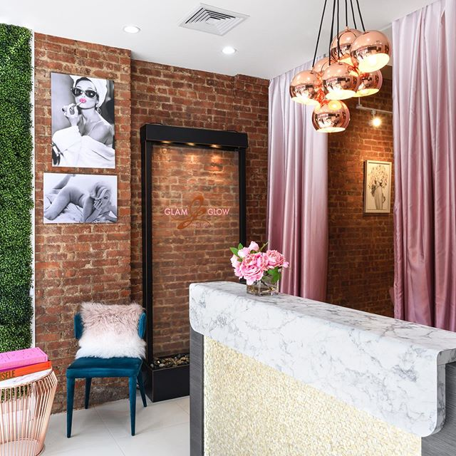 Welcoming and well appointed reception @glamglowmedspa Reclaiming the existing brick was a no brainer for its original and pretty warm hue (and budget friendliness), which was the perfect backdrop for our rose gold touches and custom @schumacher1889 ombré mauve drapes, aren't they fabulous!?! 📸 @haphotography.nyc #firstimpressioniseverything #receptiondecor #welcomingdesign #commercialinteriordesign #commercialbranding #rescuedandreclaimed #studiobigny