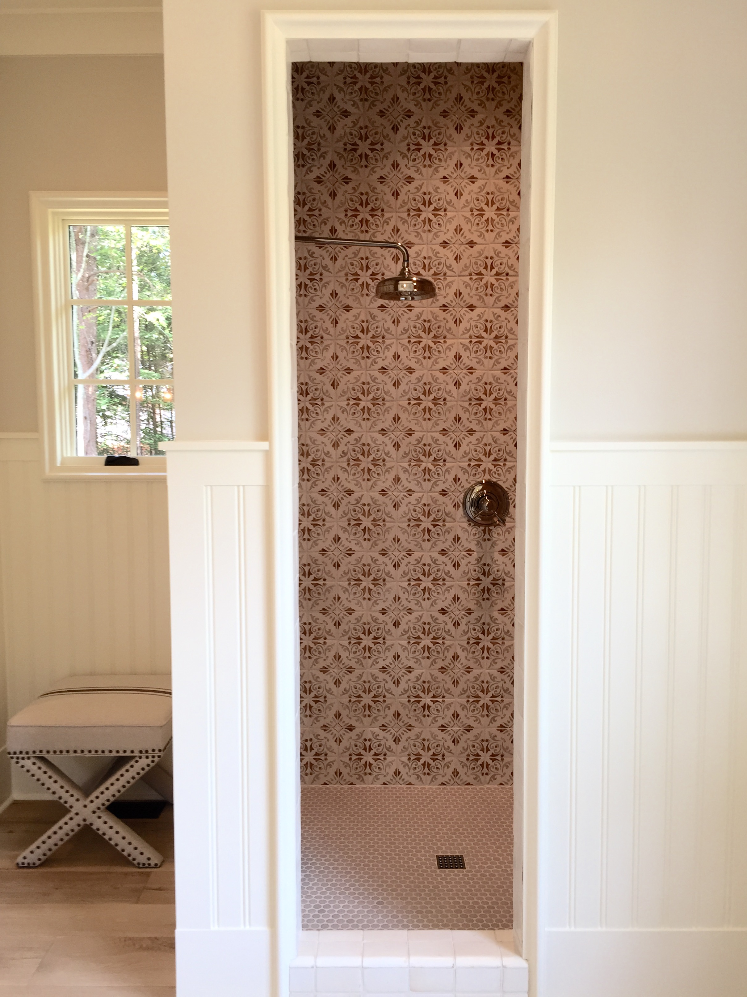 A deep red tile was the only pop of color in this otherwise white bathroom.