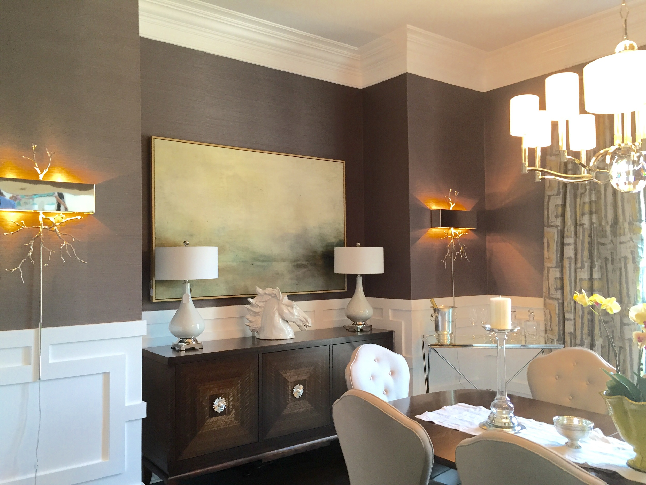 Soft purple grasscloth flowed into this dining room and was paired with elegant light fixtures and comfortable seating.