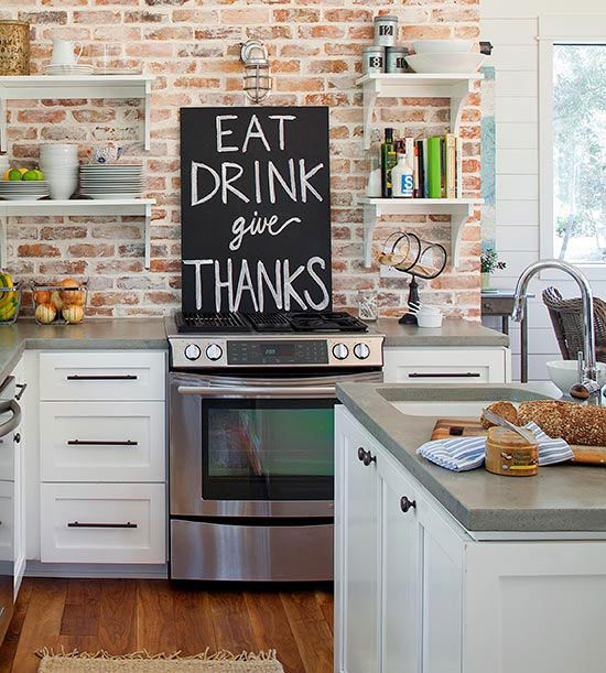 From  Liz Marie Blog   Using open shelving allows for more space to showcase the exposed brick. A small wall above cabinets can be a great space to test out the brick look.