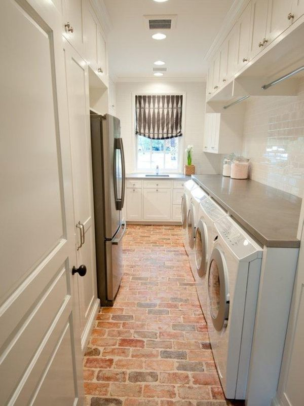 From  homedit   Exposed brick is also a great option for floors! These floors pop when paired with white cabinets in this gorgeous laundry room.