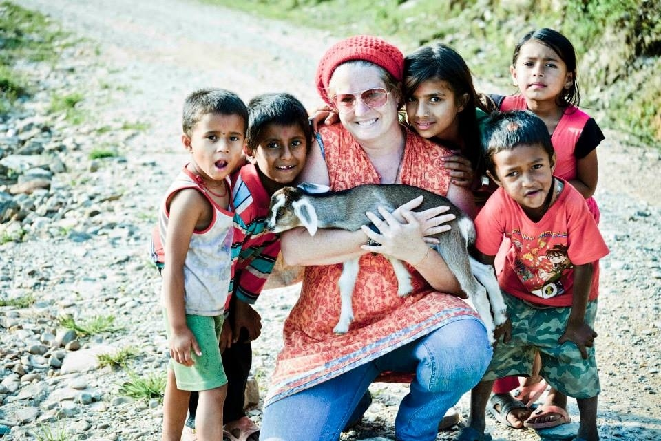While taking a walk in a  Nepalese village ,some kids flocked around me.One of them gave me his pet goat. It made me happy.