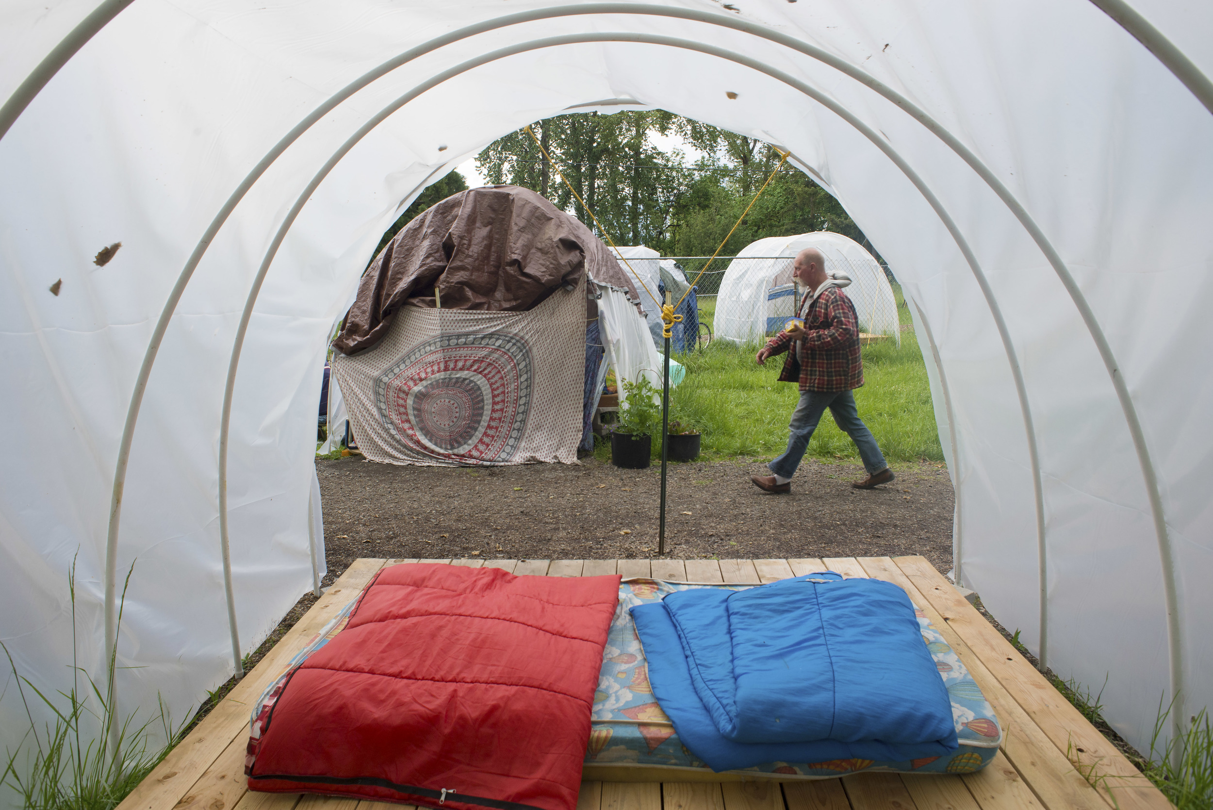 Eugene, Ore. - Mike Myers, site manager and resident of the Nightingale Health Sanctuary, helps maintain rules and structure within the camp. By: Debra Josephson