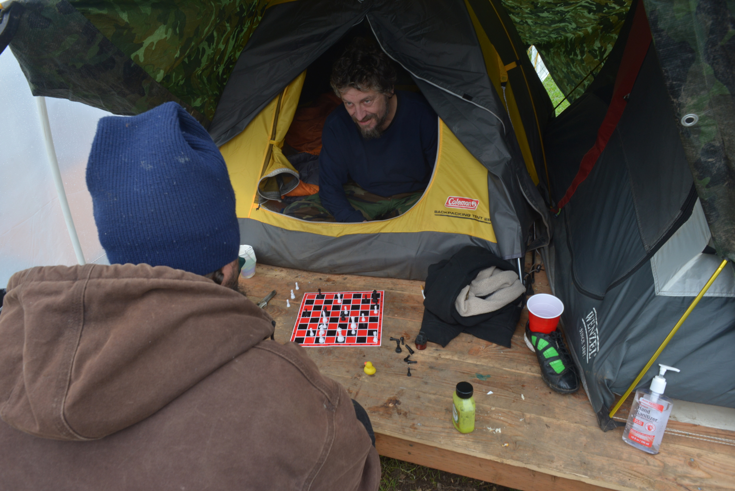 Eugene, ORE - Residents of the Nightingale Health Sanctuary playing chess in their conestega housing. By: Debra Josephson