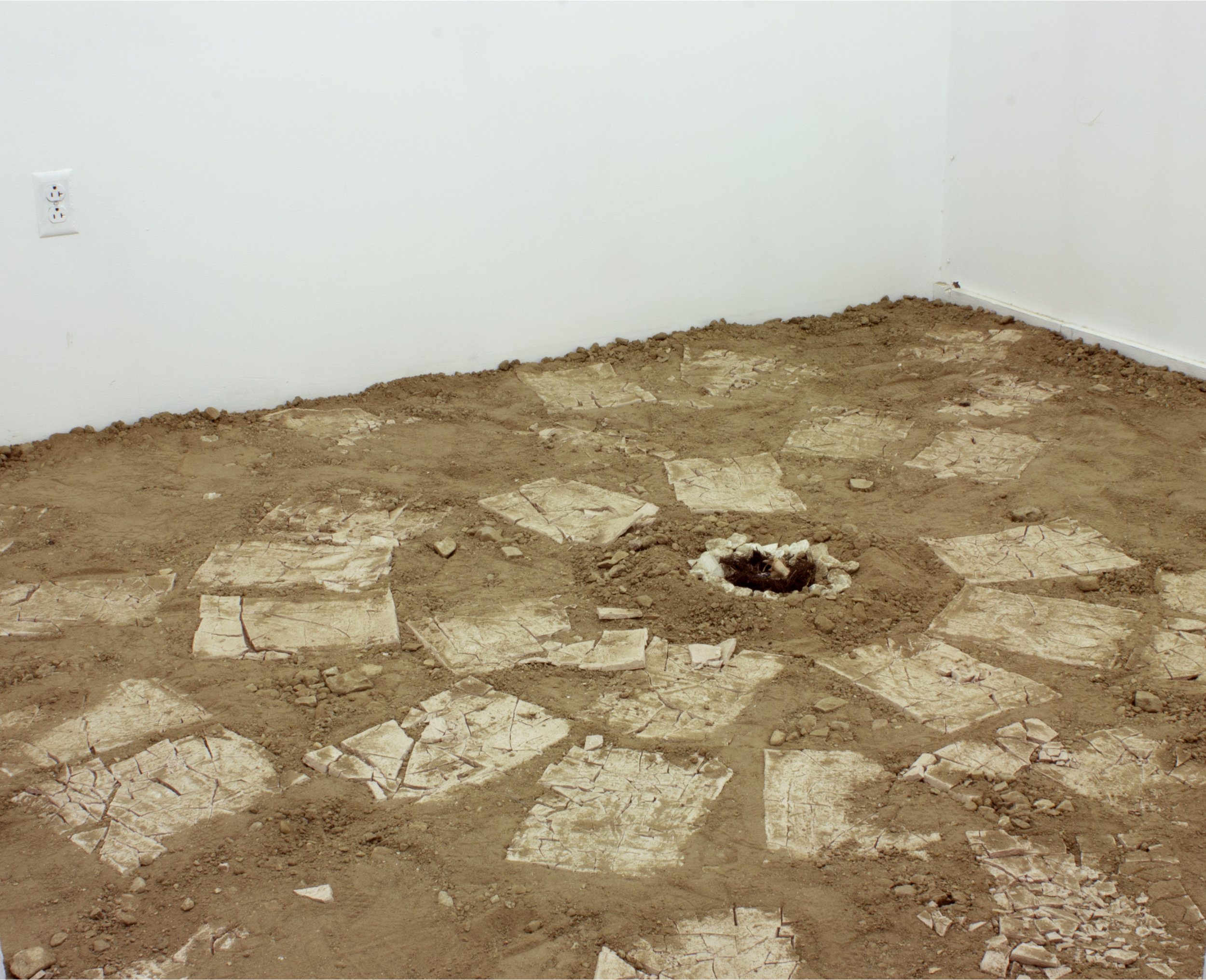 "hope is  (after entry)   Dirt from 5'2"" x 2' x 2' hole,  40 Unfired Clay Tablets, White Rocks, Roots, Detritus Cloth, and Ring   9' x 8.5' x 10'  2016"