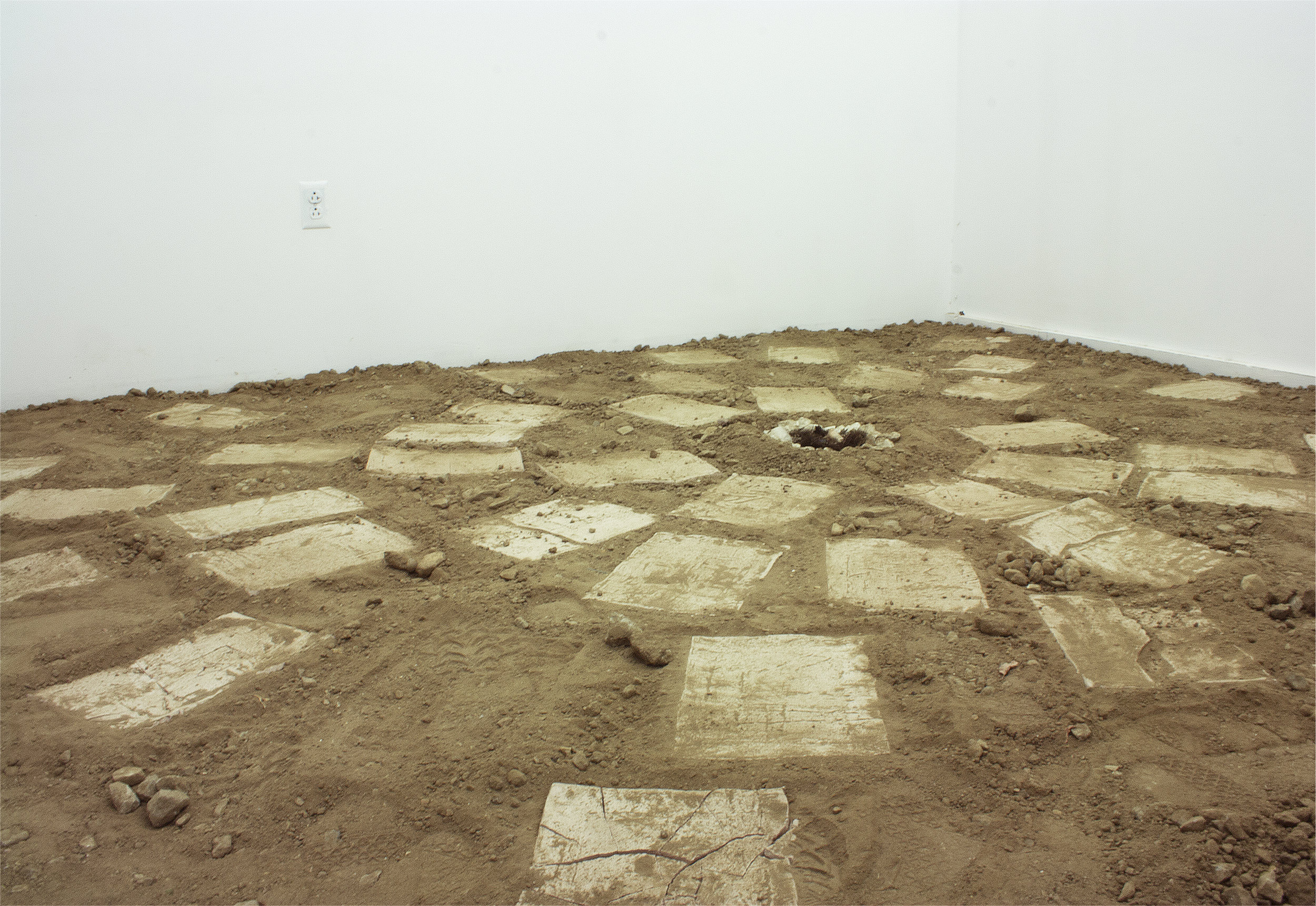 "hope is  (before entry)   Dirt from 5'2"" x 2' x 2' hole,  40 Unfired Clay Tablets, White Rocks, Roots, Detritus Cloth, and Ring   9' x 8.5' x 10'  2016"