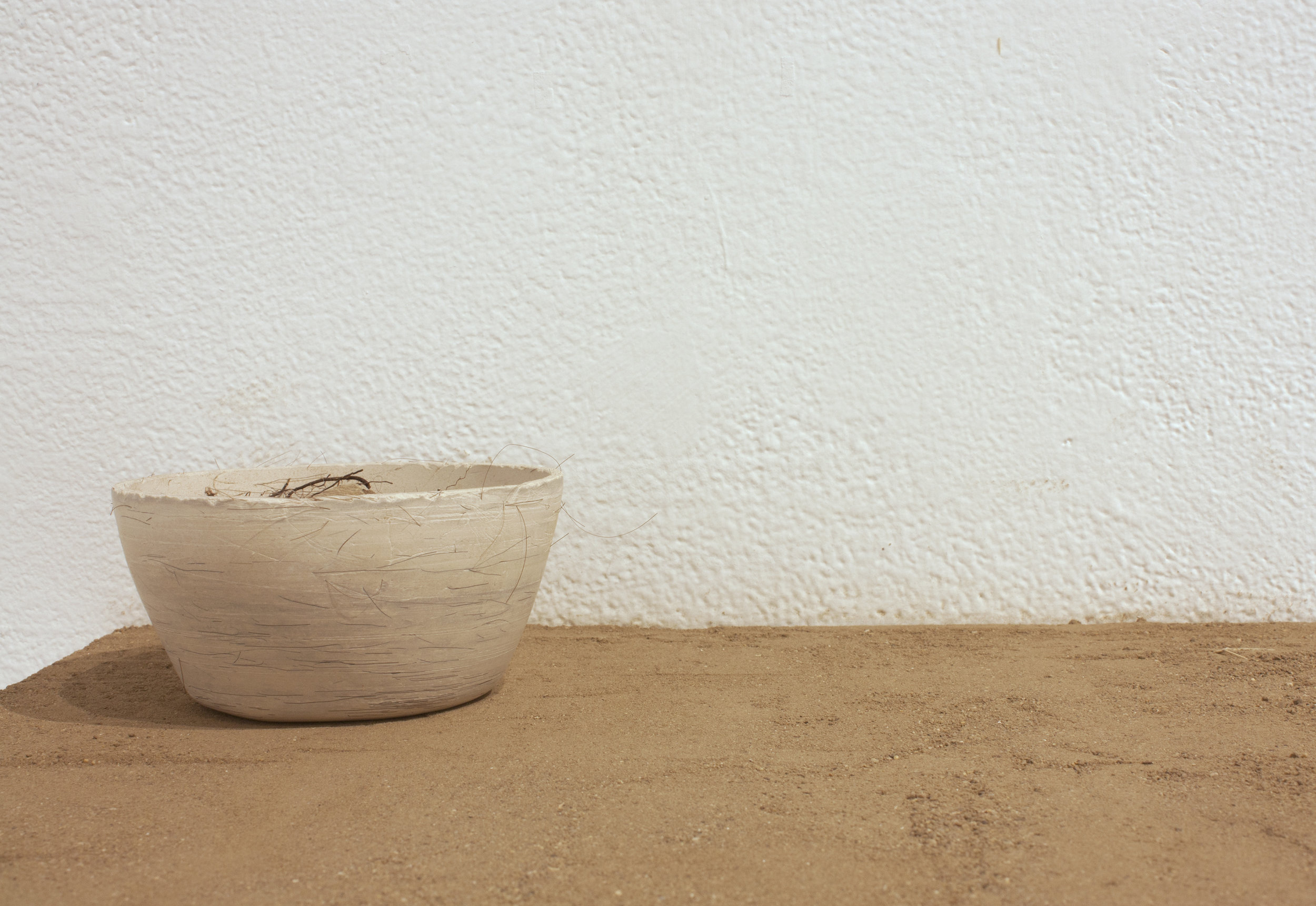 a cyclical desire for    Sifted Dirt, Porcelain with Hair, and Dried Roots   4' x 2' x 2'  2016
