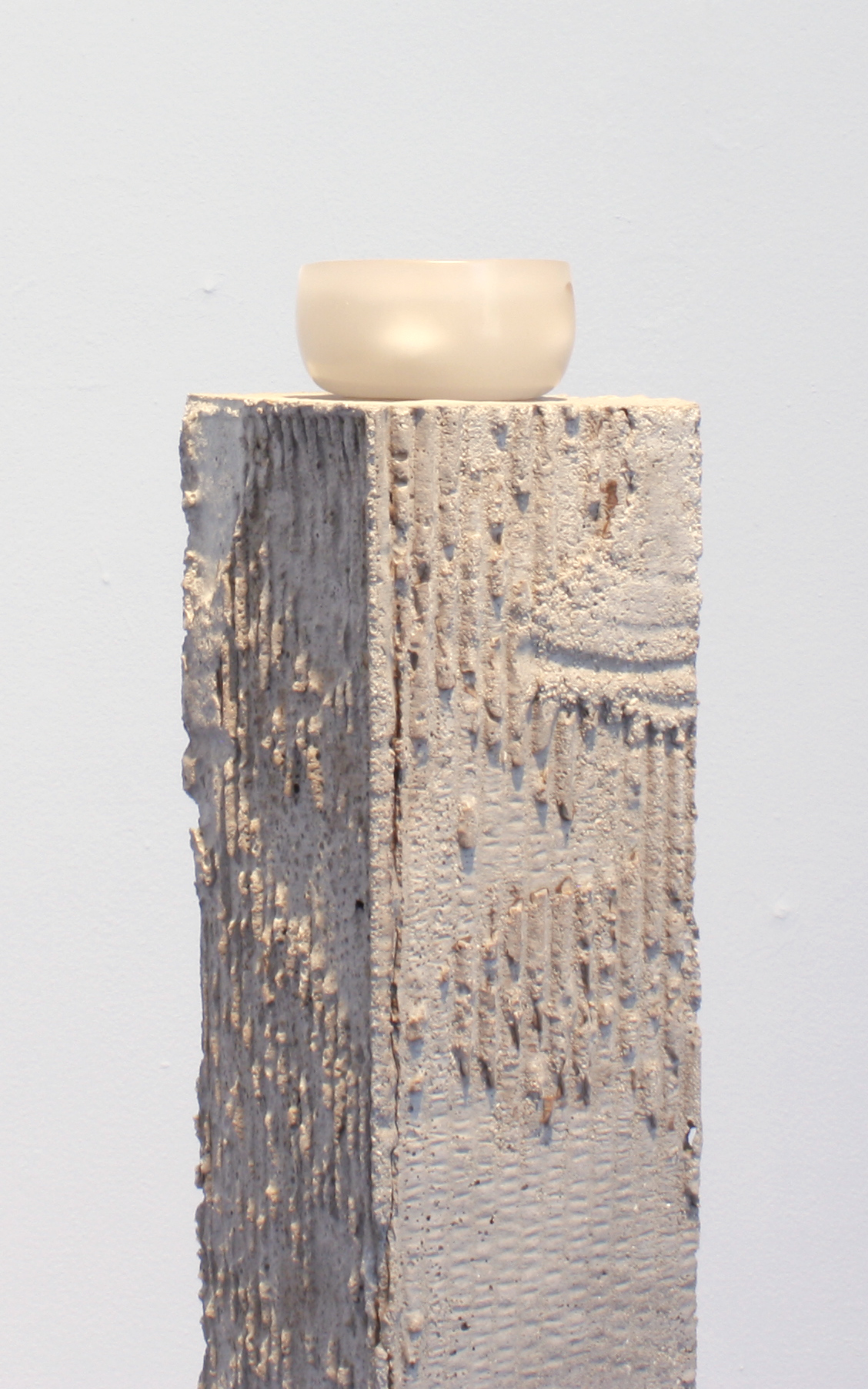 """someday    Concrete, paraffin wax, sifted earth, and light   4.5"""" x 5"""" x 38""""  2017"""