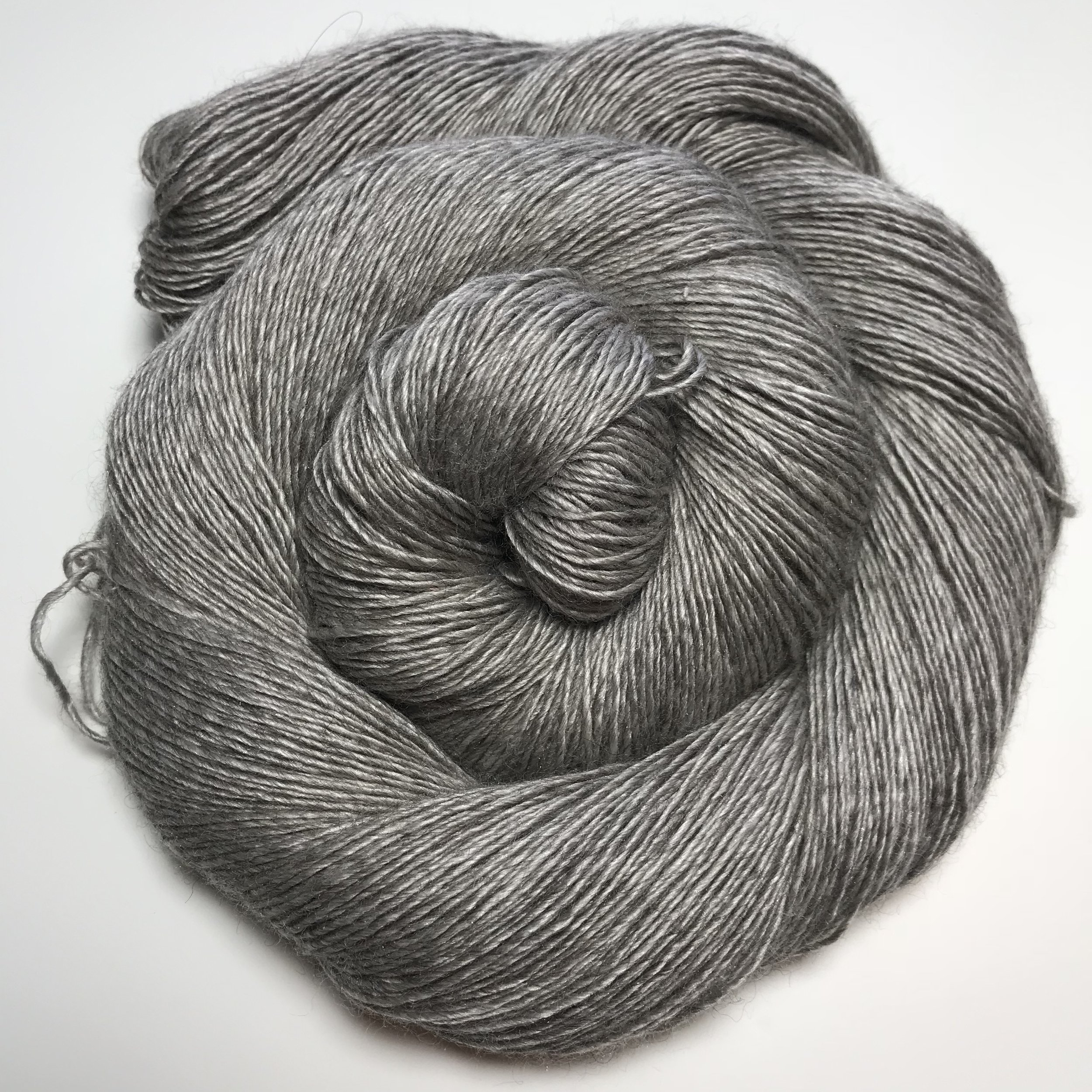 Wooly Silky Yak - $45 This is a gorgeous single ply fingering yarn that is 65% SW Merino/ 20% Silk/ 15% Yak. Its a very soft luxury fiber that dyes up beautifully over the gray fiber. It's also gorgeous by itself. Recommended Needle Size: 2.5 - 4mm needles. Gauge (stocking stitch): 28sts x 36 rows over 10cm/4 inches on 3.25mm (US 3) needles. 120g/523yds