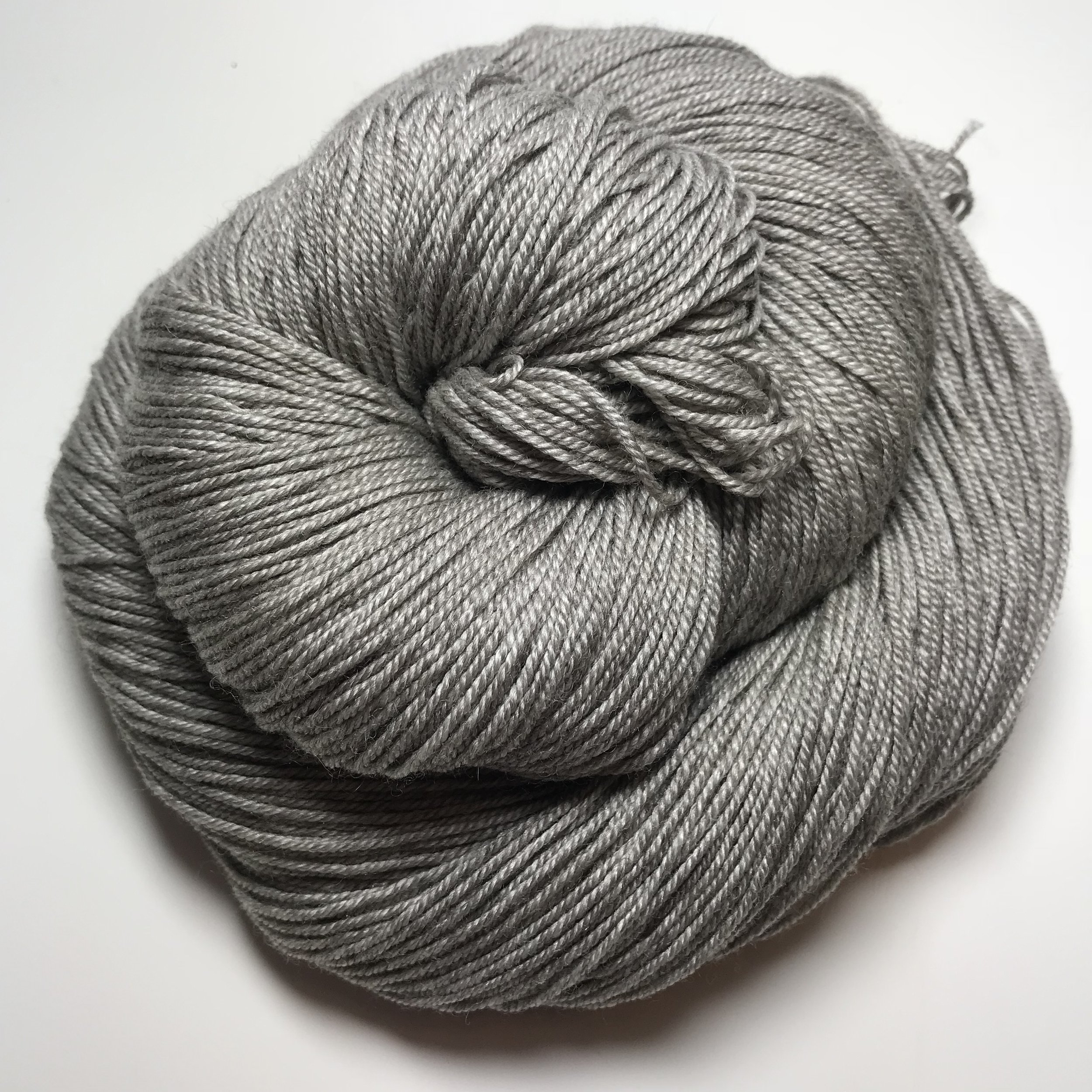 Queen Bee Sock - $40 3-ply 65/20/15 SW Merino/Silk/Yak. This is an absolutely luxurious yarn base. The gray brings a richness to every color that is put on top of it. Recommended Needle Size: 2.5-4mm (US 1-6). Gauge (stocking stitch): 28sts x 36 rows over 10cm (4 inches) on 3.25mm (US 3) needles.100g/400m/438yds