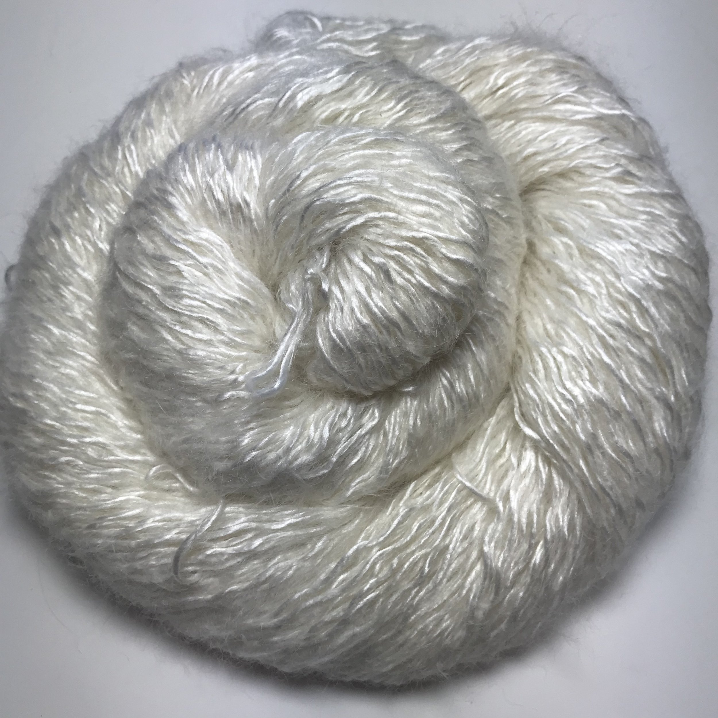 Liquid Gold - $40 69/22/9 Mulberry Silk/Kid Mohair/Nylon. Recommended Needle Size: 2.5-4mm (US 1-6). Gauge (stocking stitch): 28sts x 36 rows over 10cm (4 inches) on 3.25mm (US 3) needles.100g/350m/382yds