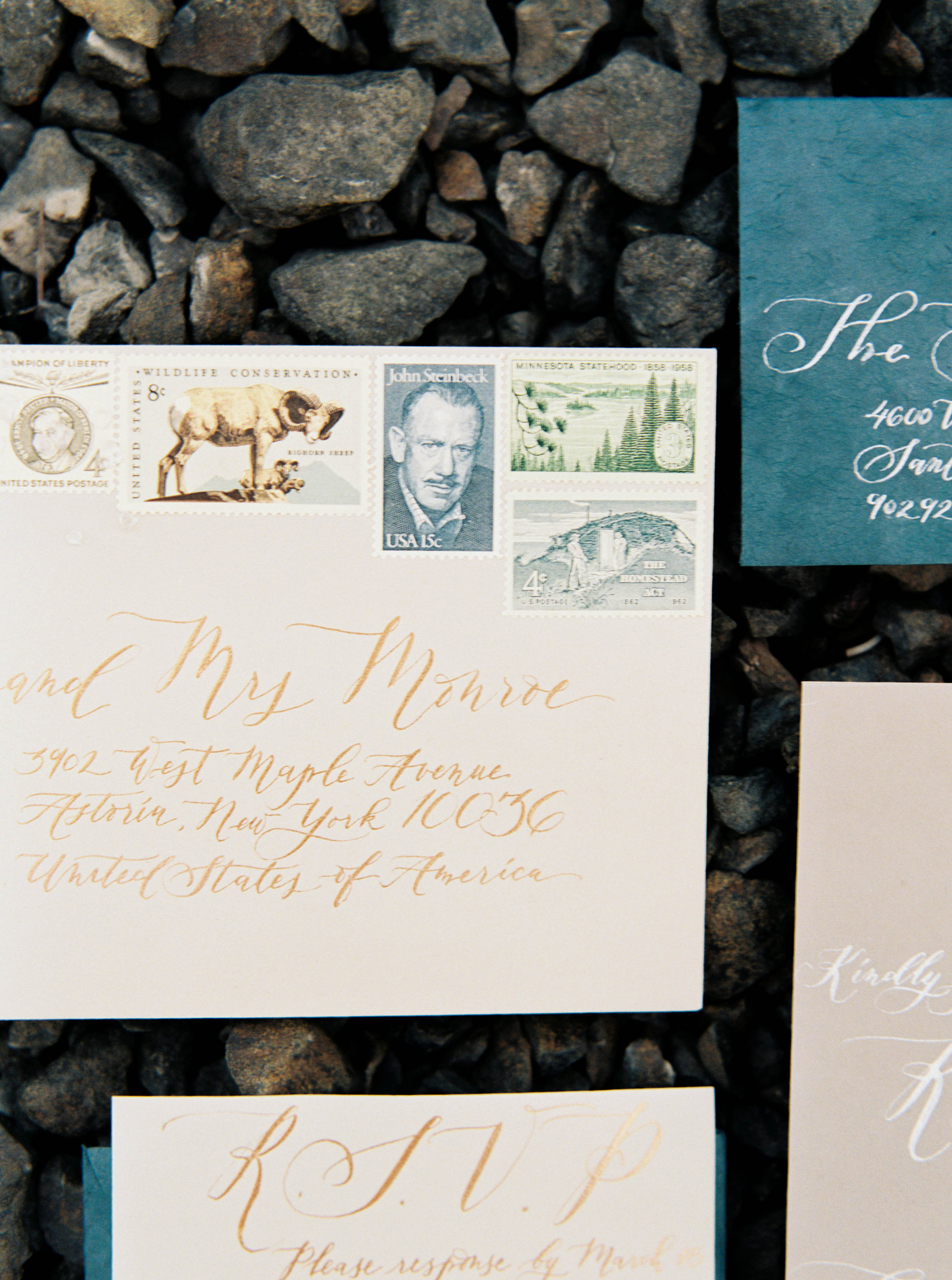 Let's talk about some tips to pull a cohesive look with your vintage stamps. For this shoot, I use a combination of animal and landscape theme with some basic single color vintage stamps that complement the copper from the ink and the some of the deep blue from the invitation suite.