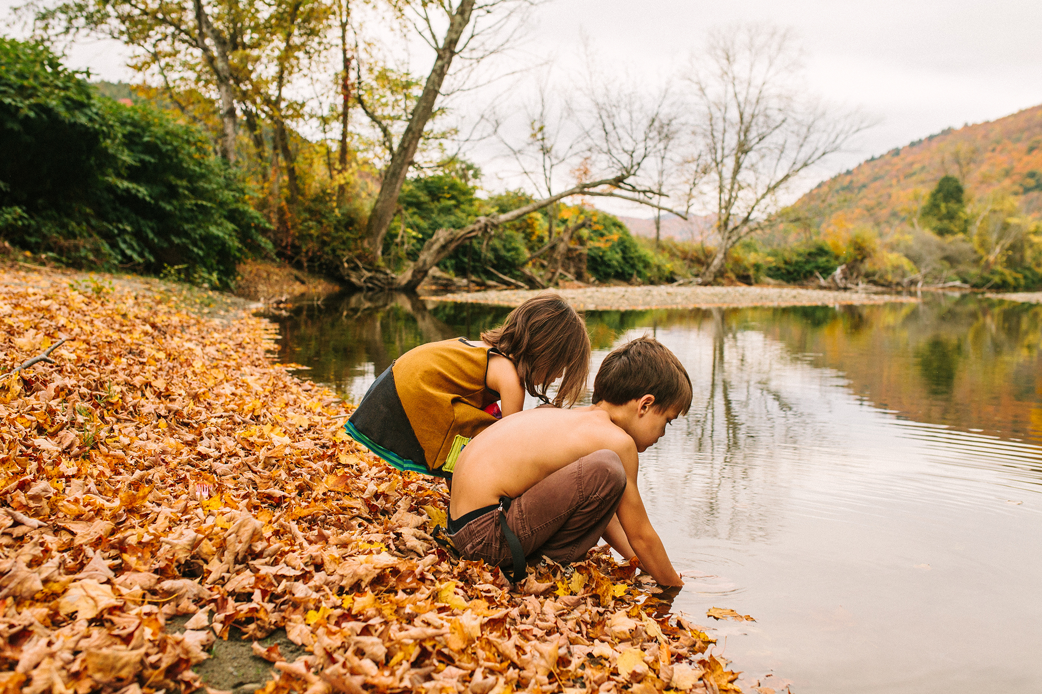 children playing in vermont river family session web.jpg