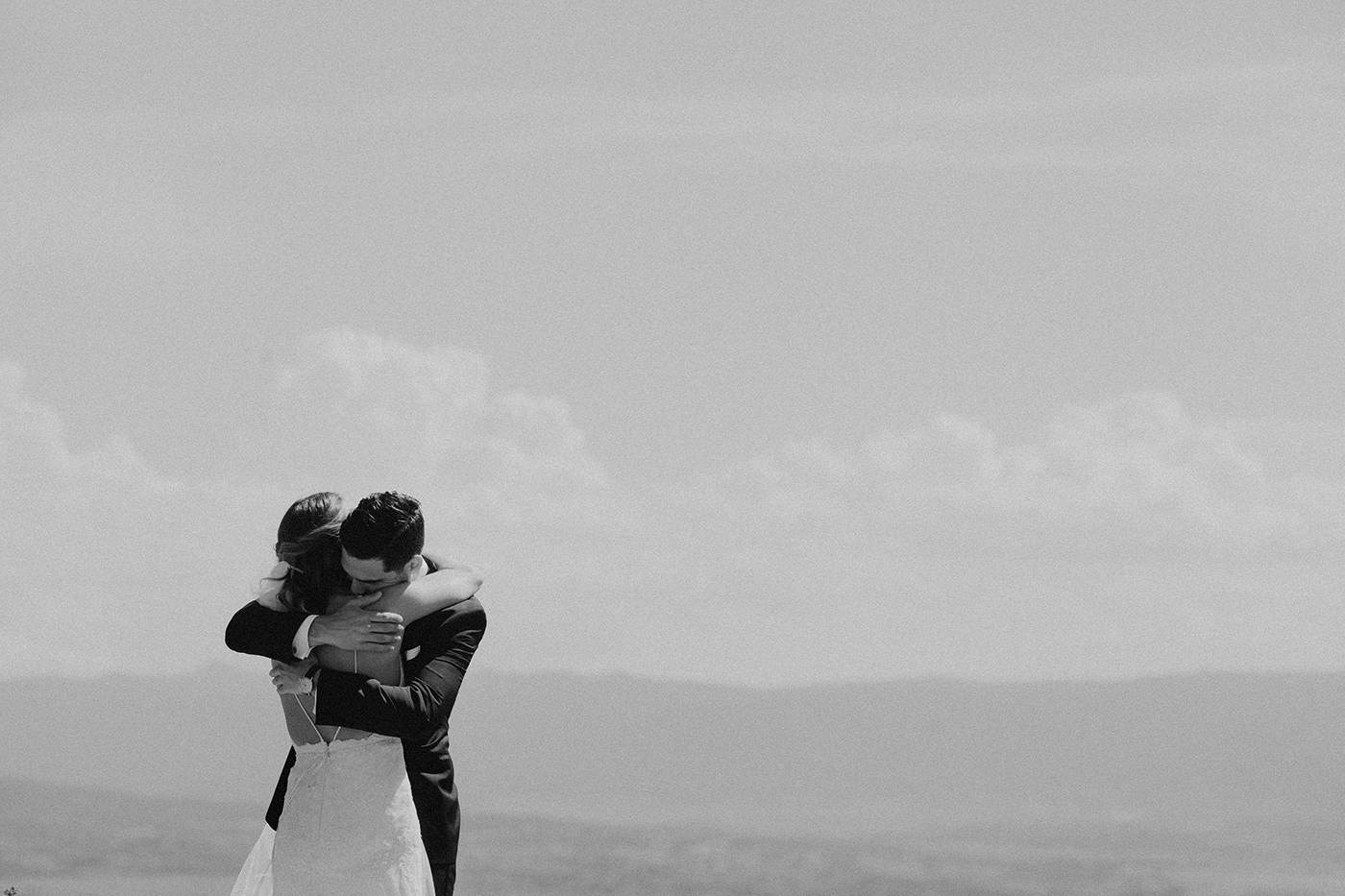 denver-colorado-wedding-first-look-hugging-bride-groom-bw.jpg