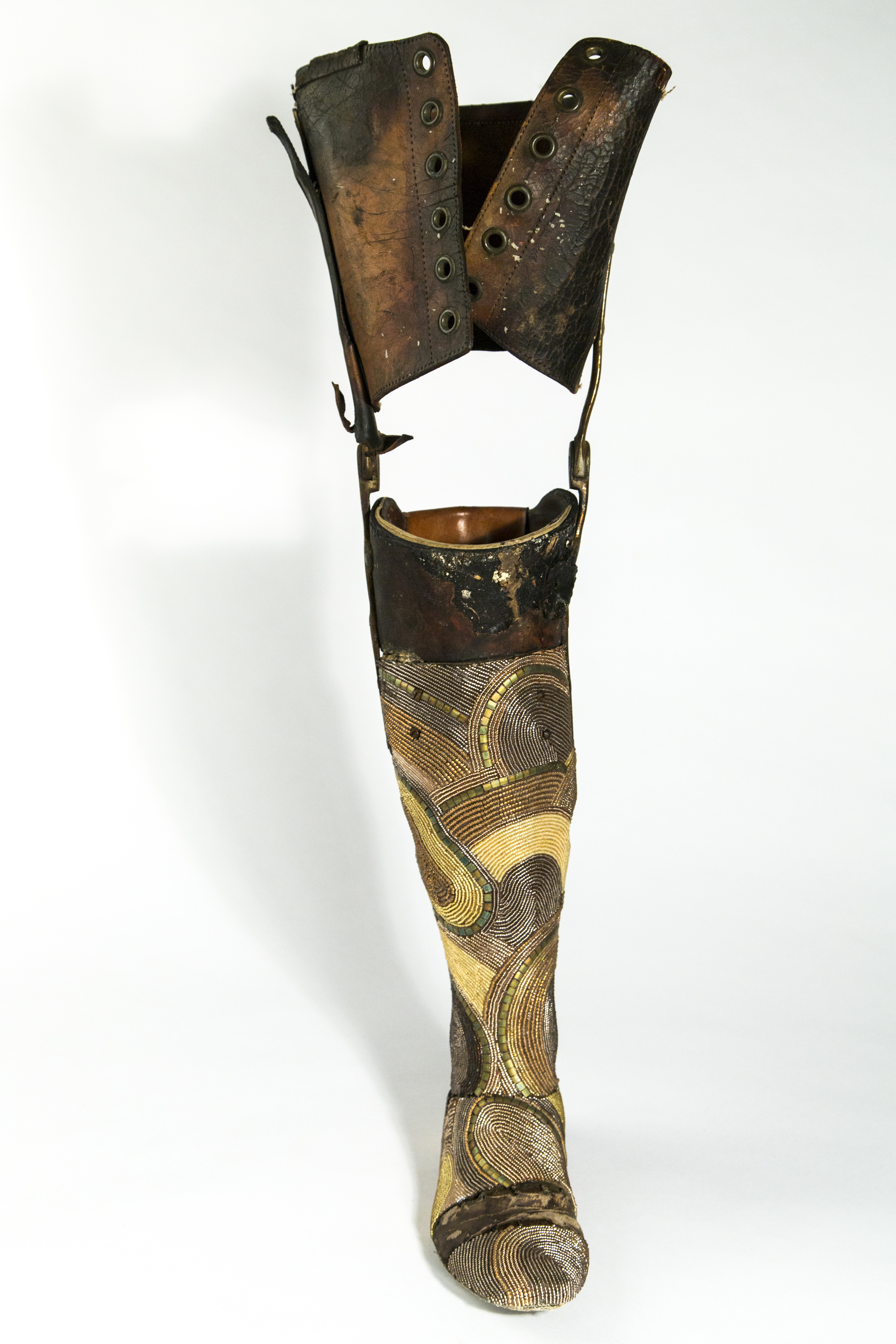 "the veteran.  2014. seed beads, prosthetic leg, glue, 27.5"" x 4.25"" x 9.5"""
