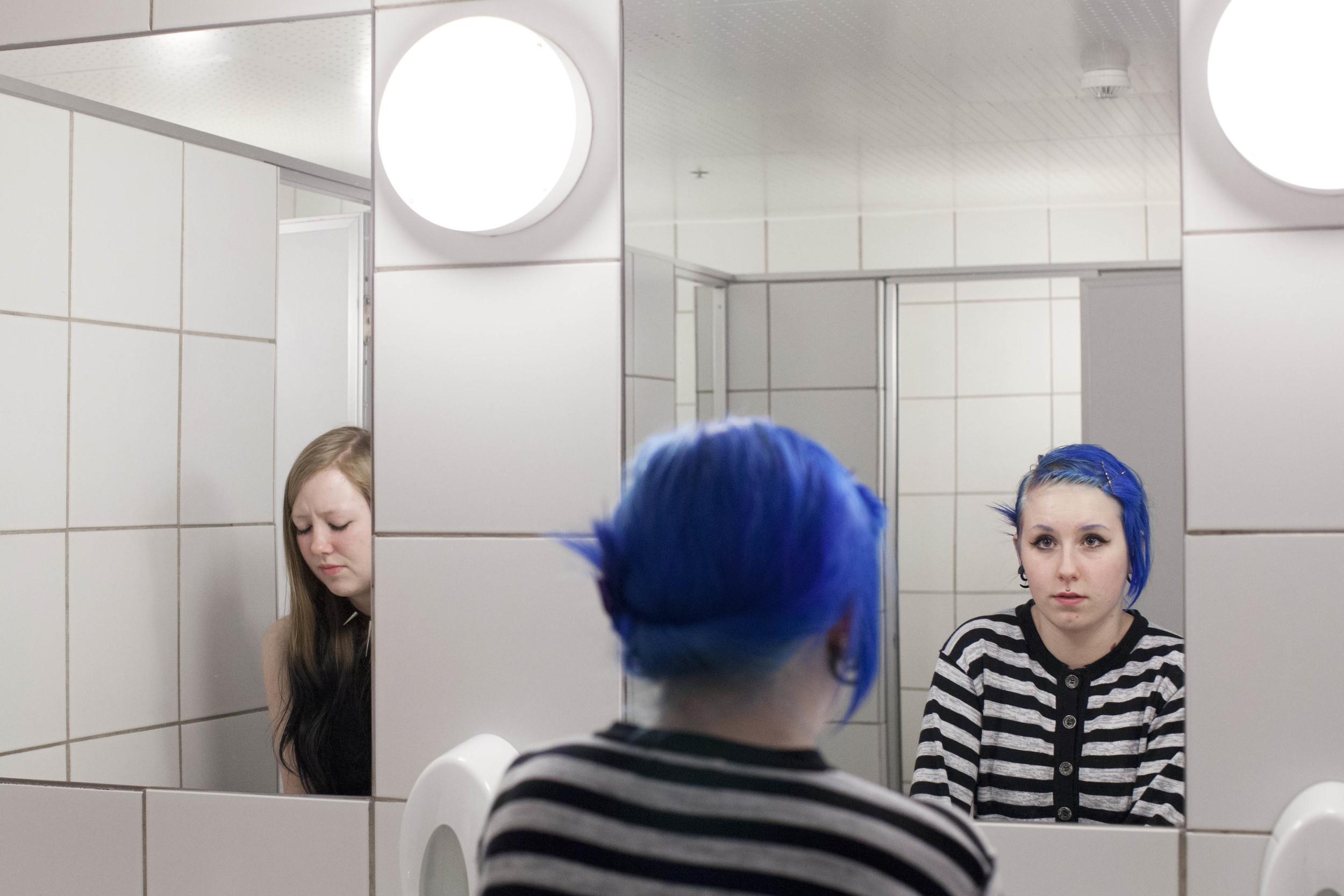 """Kristin """"Billy"""" Benjaminsen and Henriette Prytz at the public toilet downtown Stavanger."""
