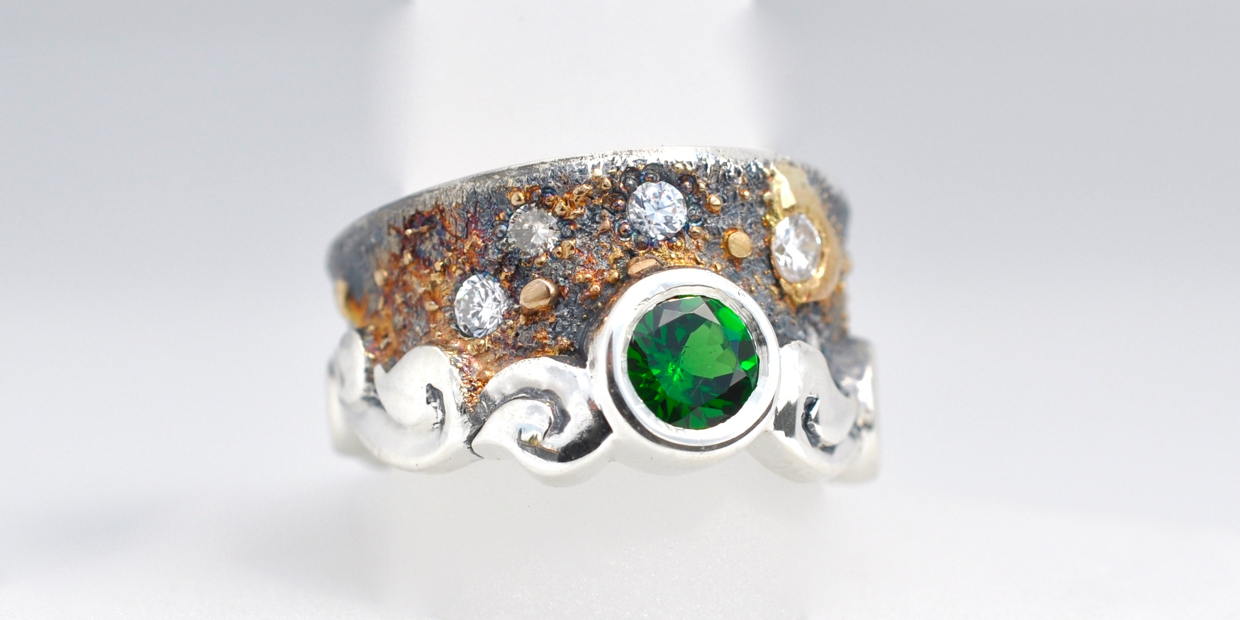 1.00 Carat Tsavorite Garnet with .45 cttw round diamond melee set in sterling silver with 18k gold fused accents.