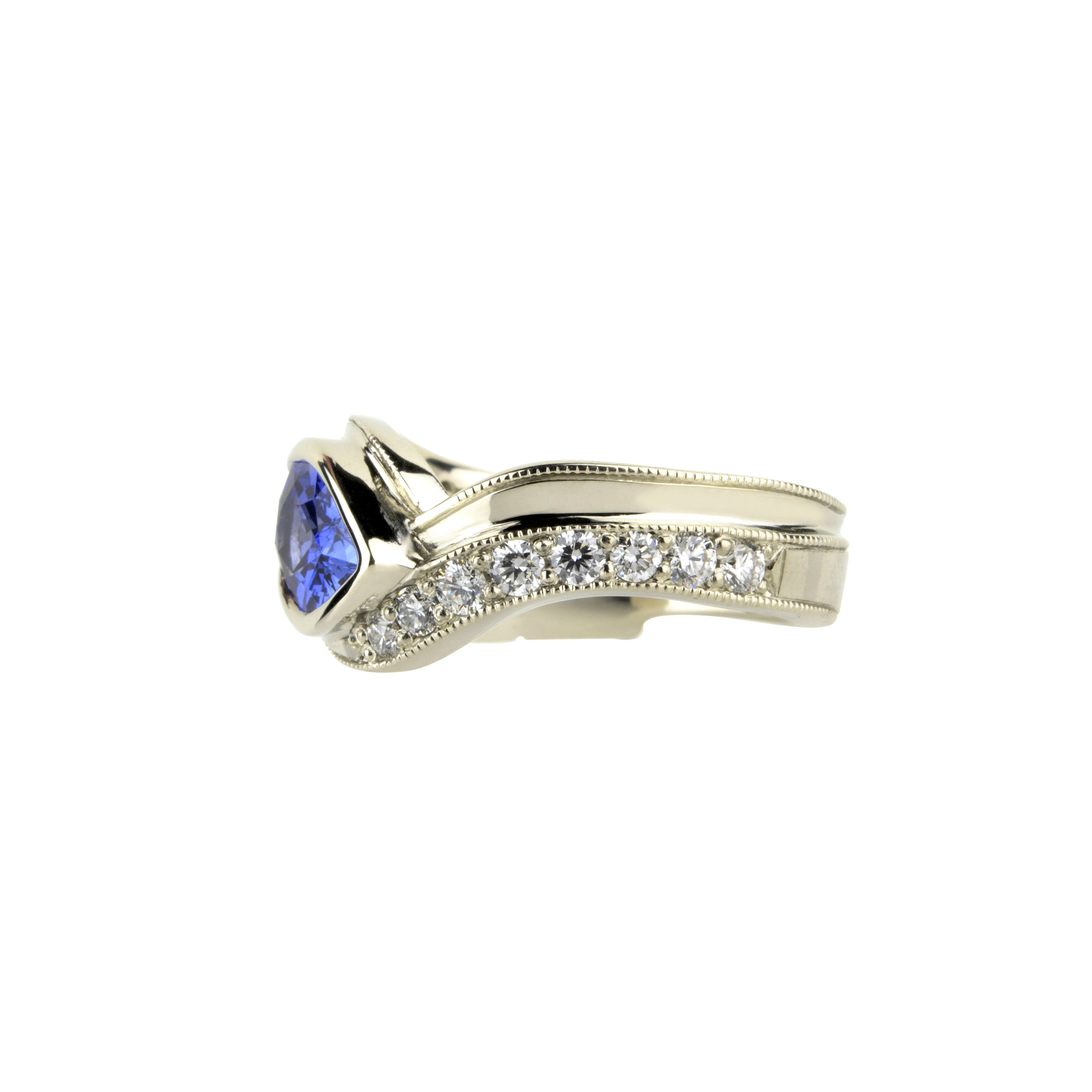 18kw Feather and Blue Sapphire Ring with Diamonds