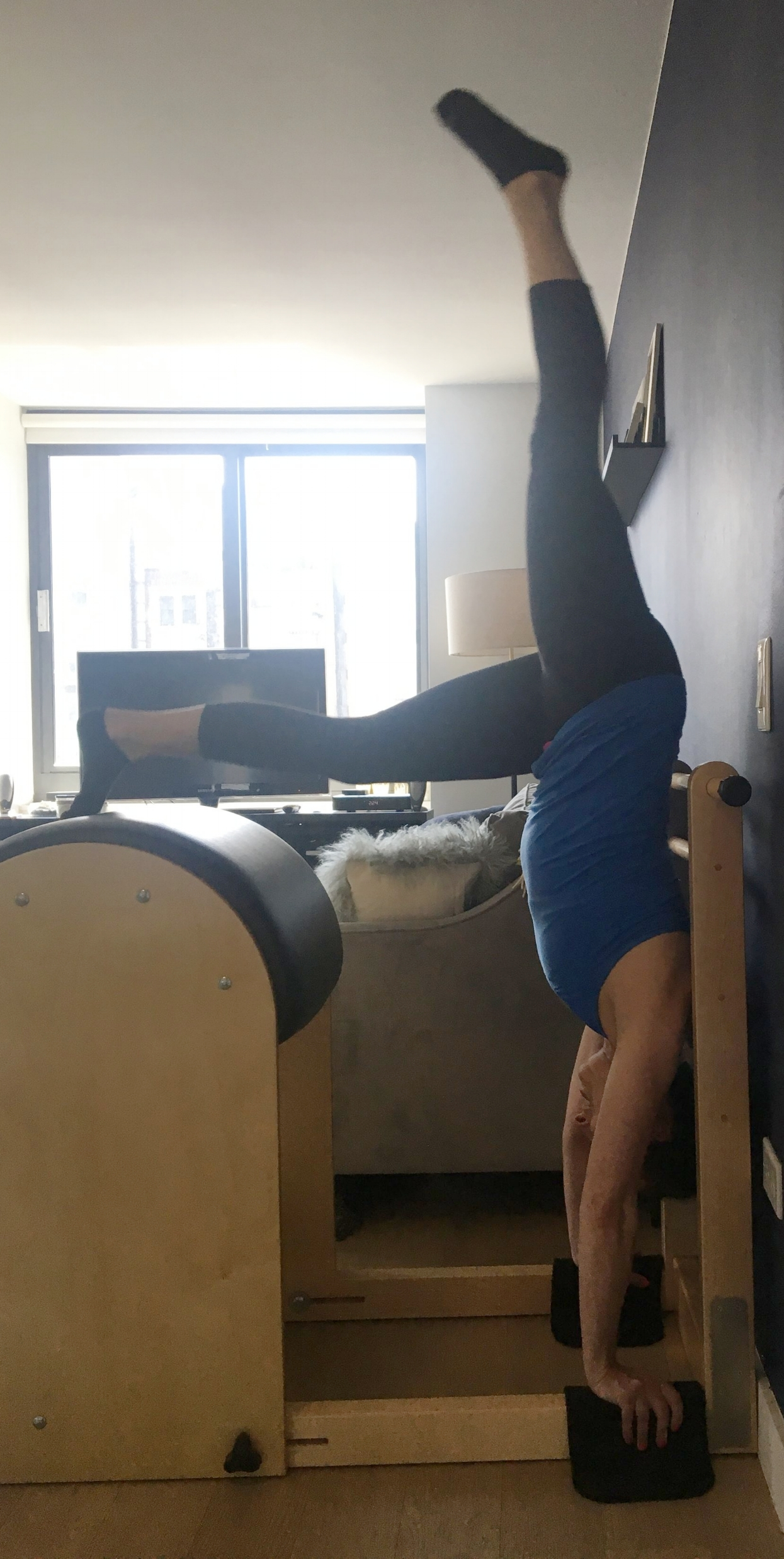 A beautiful handstand prep on the ladder barrel performed by Sarah, owner of The Pilates Line NY!