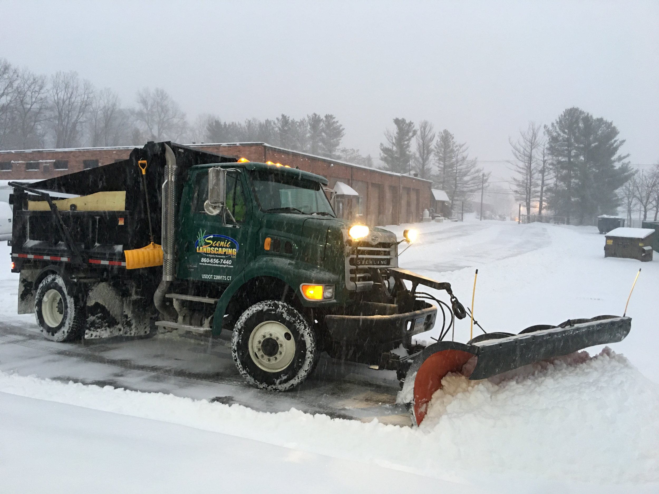 our team pushing snow out