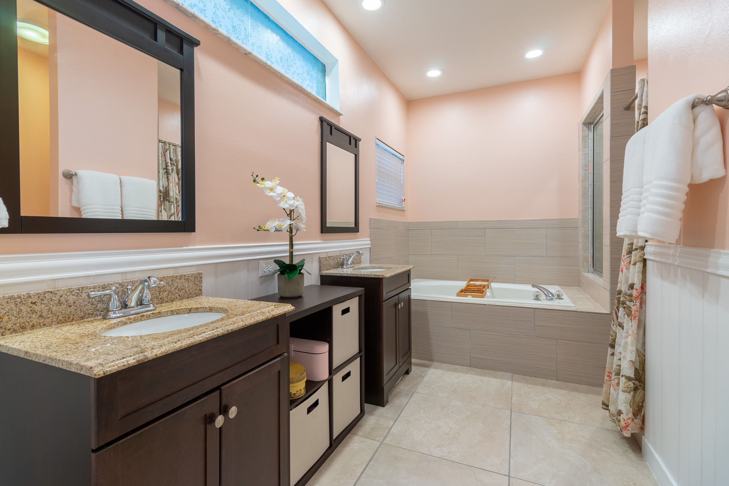 Pale pink bathroom with two twin sinks