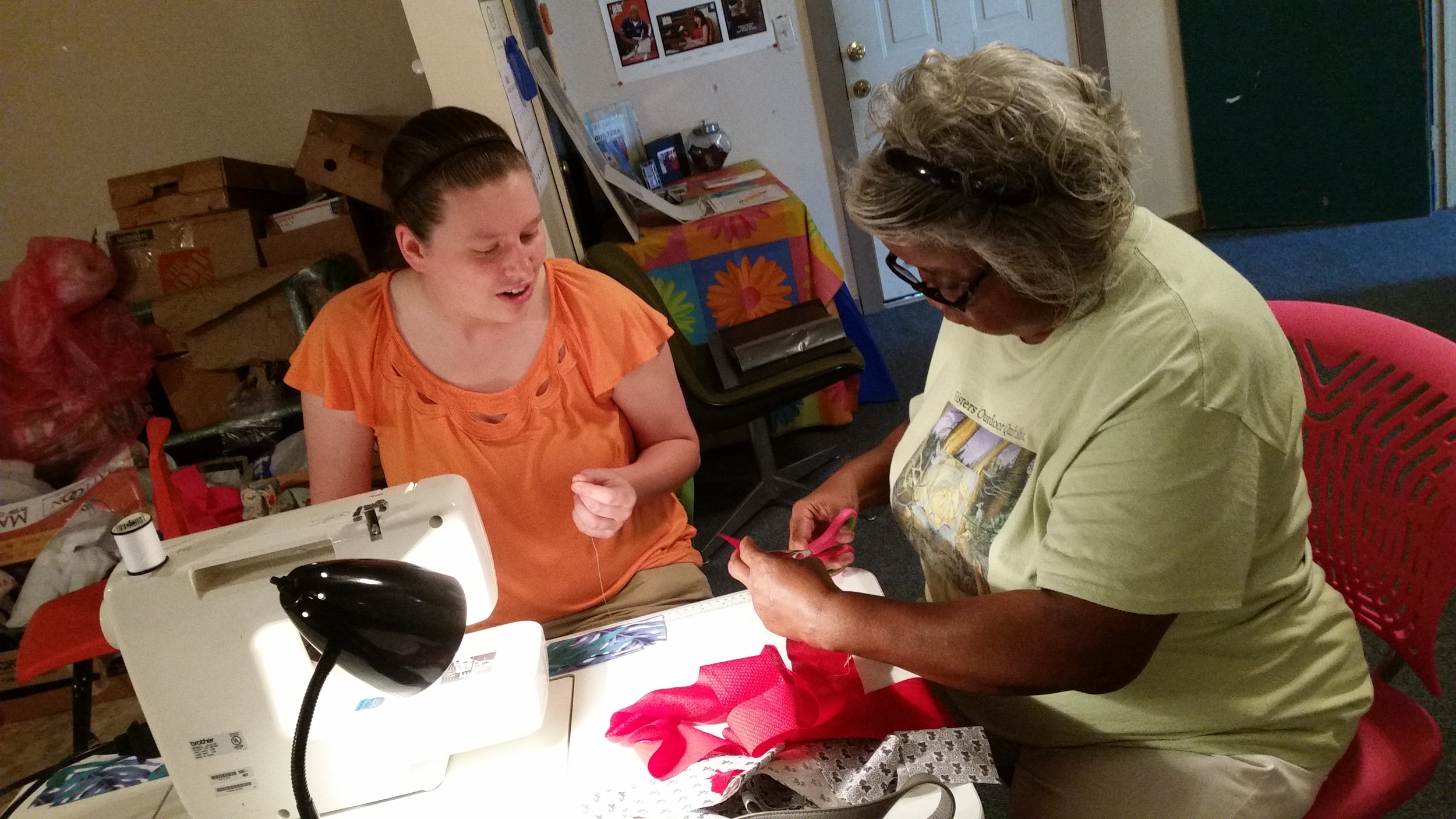 """Mary Ann Pettway teaches Whitley how to sew like, """"my momma taught me."""""""
