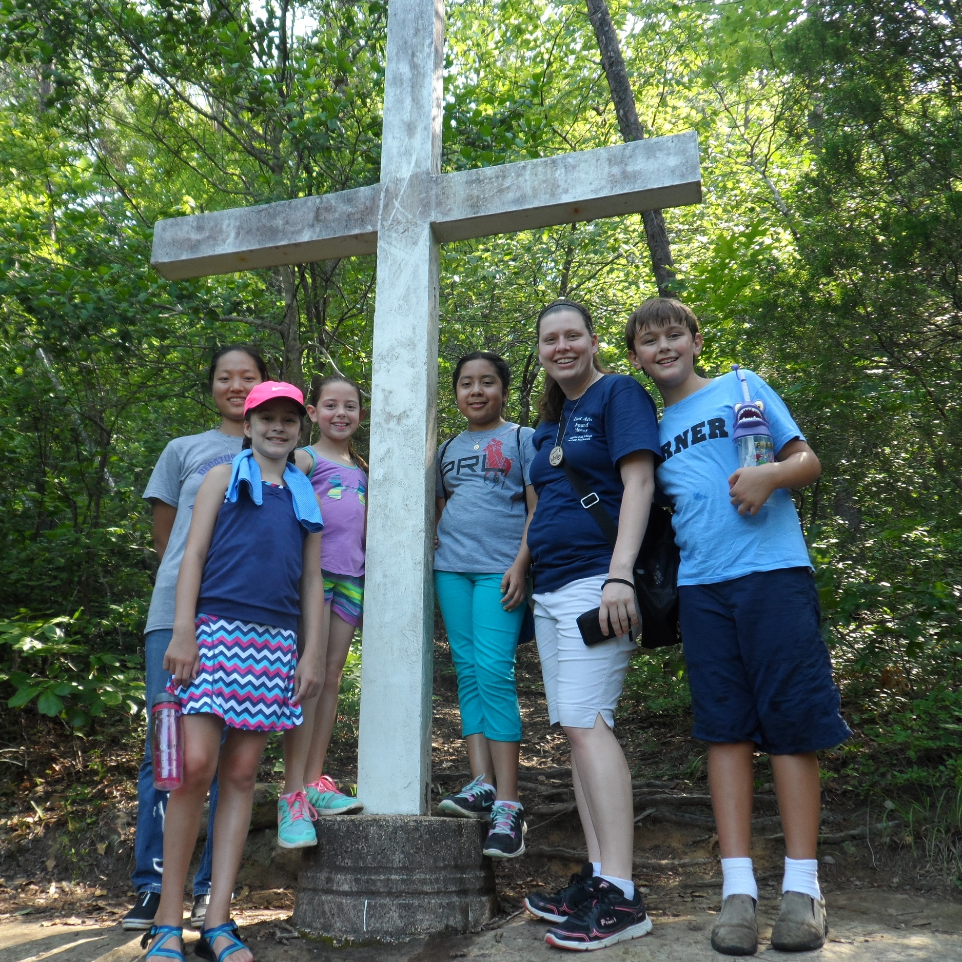 Whitley and Youth Folk campers hike to the cross.