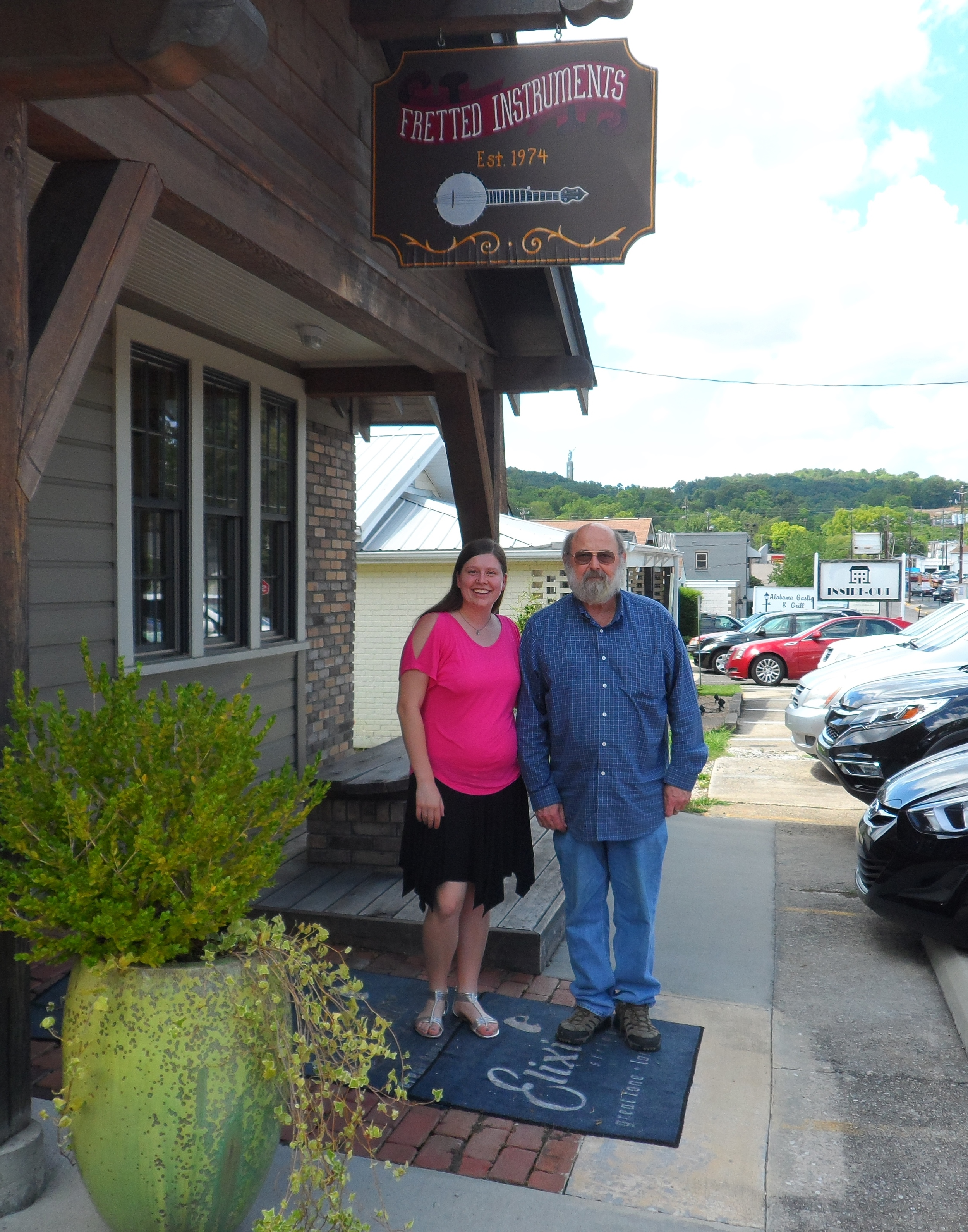 Whitley visits with Herb Trottman at Fretted Instruments in Birgmingham.
