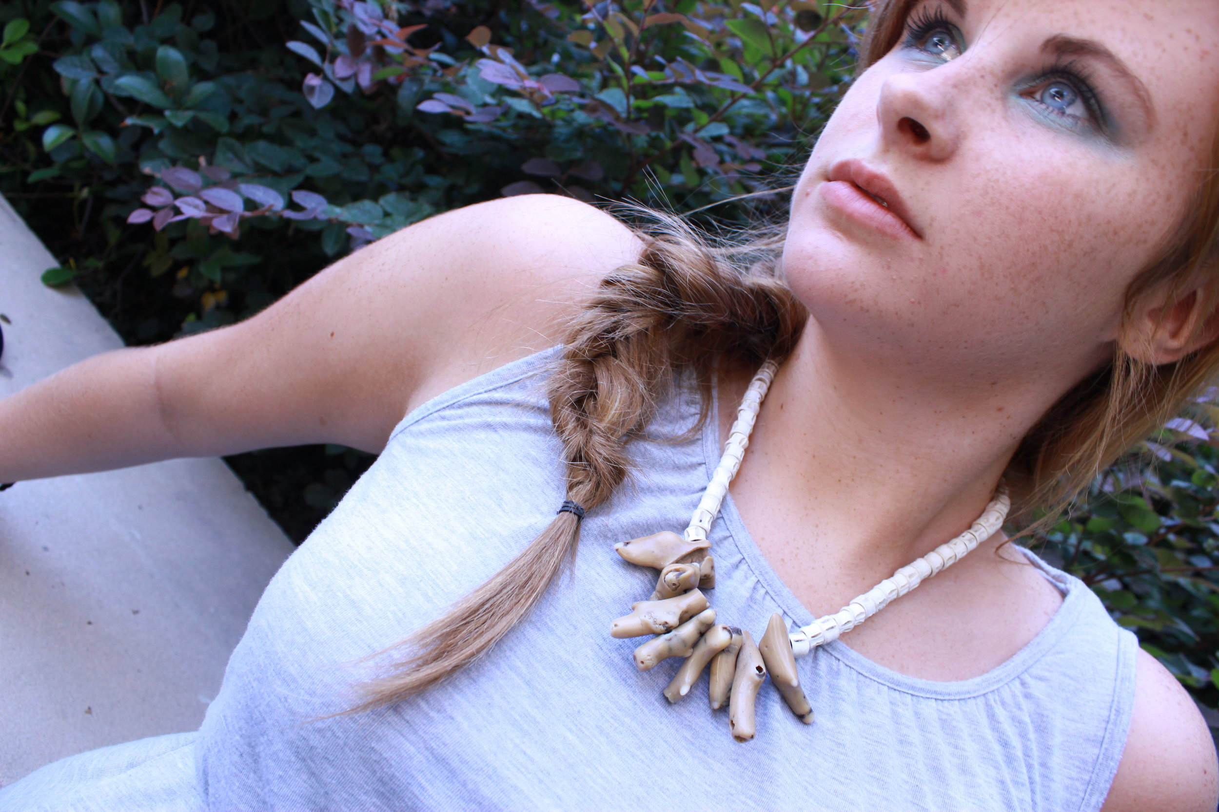 Jessie Broome modeling Fish Vertabrea & Coral Necklace