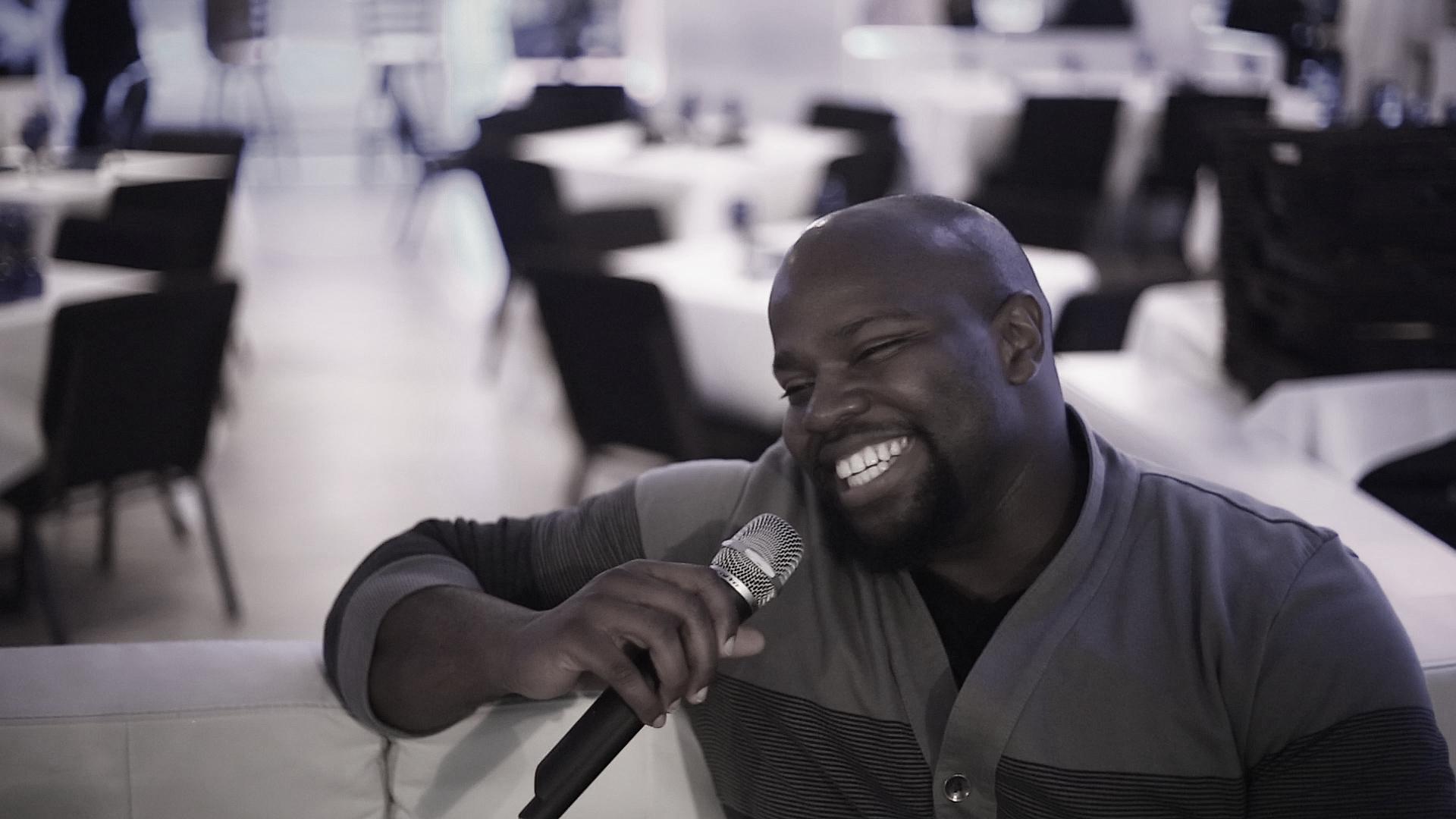 man smiling with mic.jpg