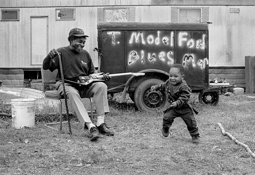 """T Model Ford and Gentle, (aka """"Stud""""), Greenville, Mississippi   © Margo Cooper All Rights Reserved. No part of this website may be reproduced, stored in a retrieval system, or transmitted in any form without prior written permission."""