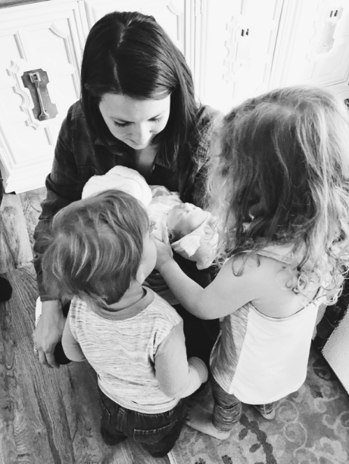 Meeting their baby sis for the first time.
