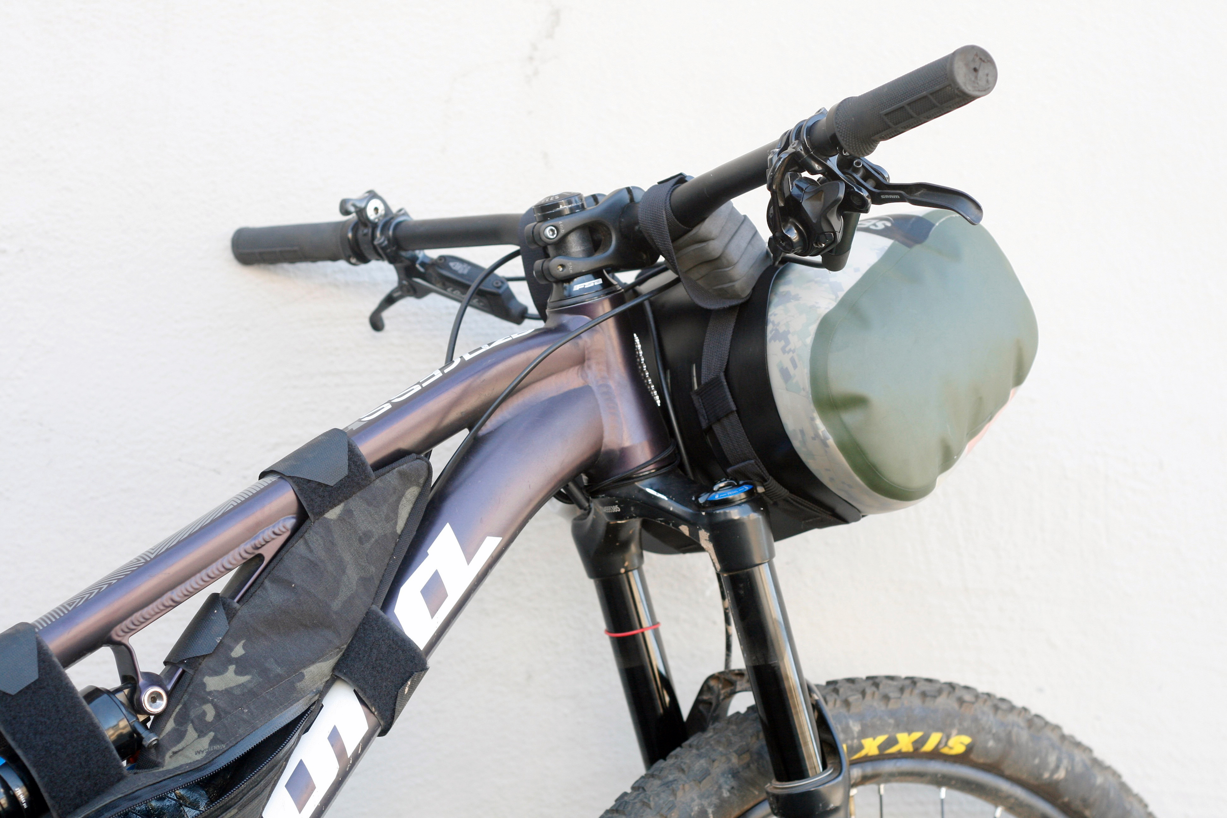 (5) spacers on each handlebar attachment, 10L dry bag shown
