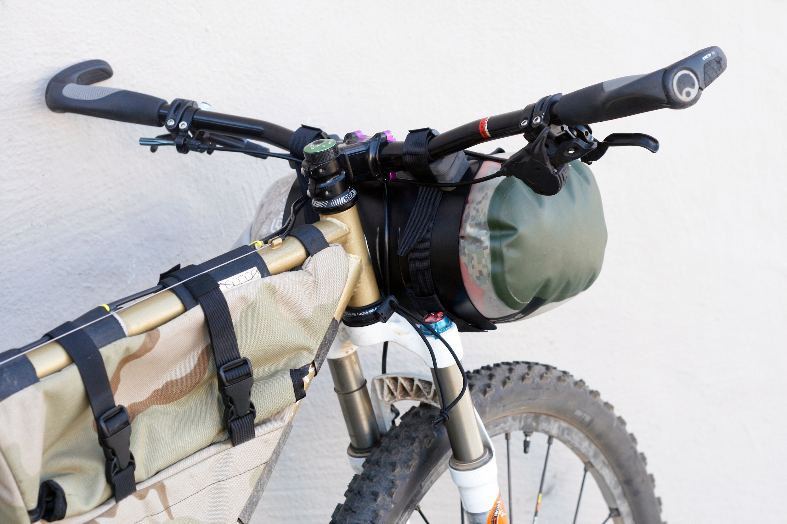 (2) spacers on each handlebar attachment, 10L dry bag shown