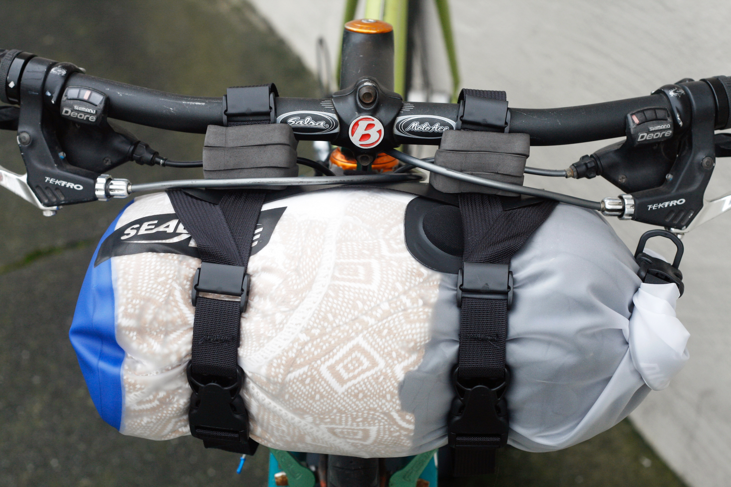 (3) spacers on each handlebar attachment, (3) spacers on lower attachment point, 5L dry bag shown, this bike doesn't fit a larger dry bag because it would run into the exposed brake cable