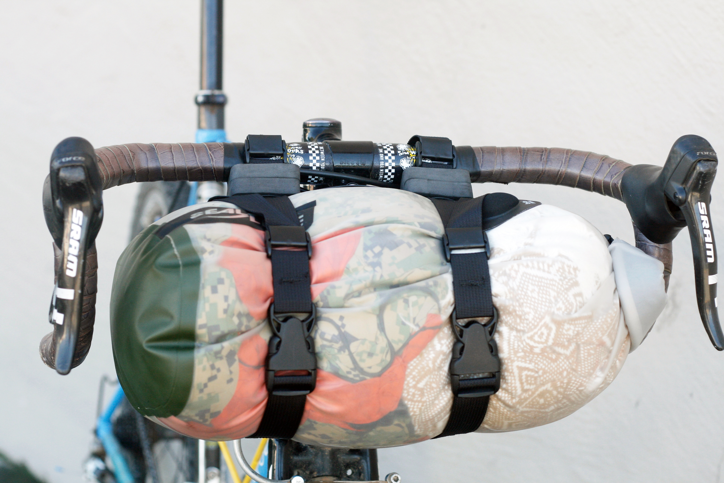 (2) spacers on each handlebar attachment, (3) spacers on lower attachment point, 10L dry bag shown, the handlebar spacers are only used to keep the top handlebar position accessible