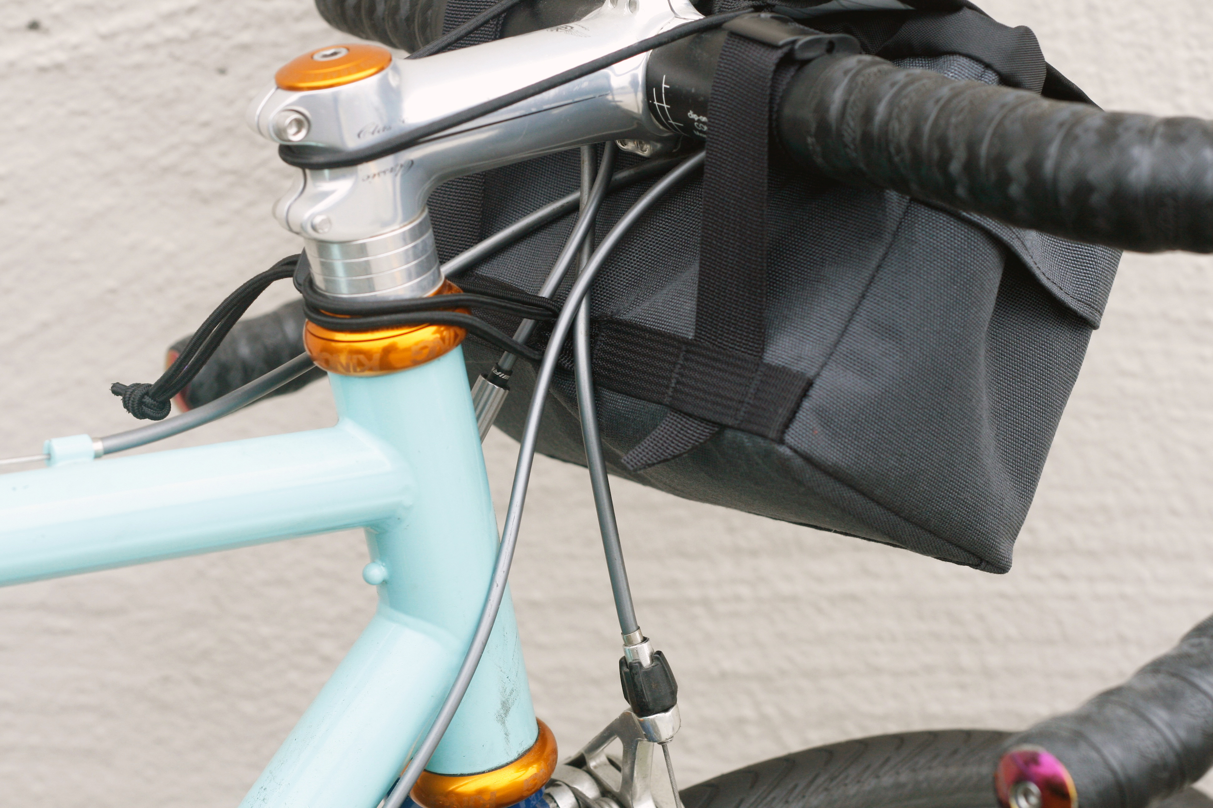 No spacers needed, bag rests gently against the cables
