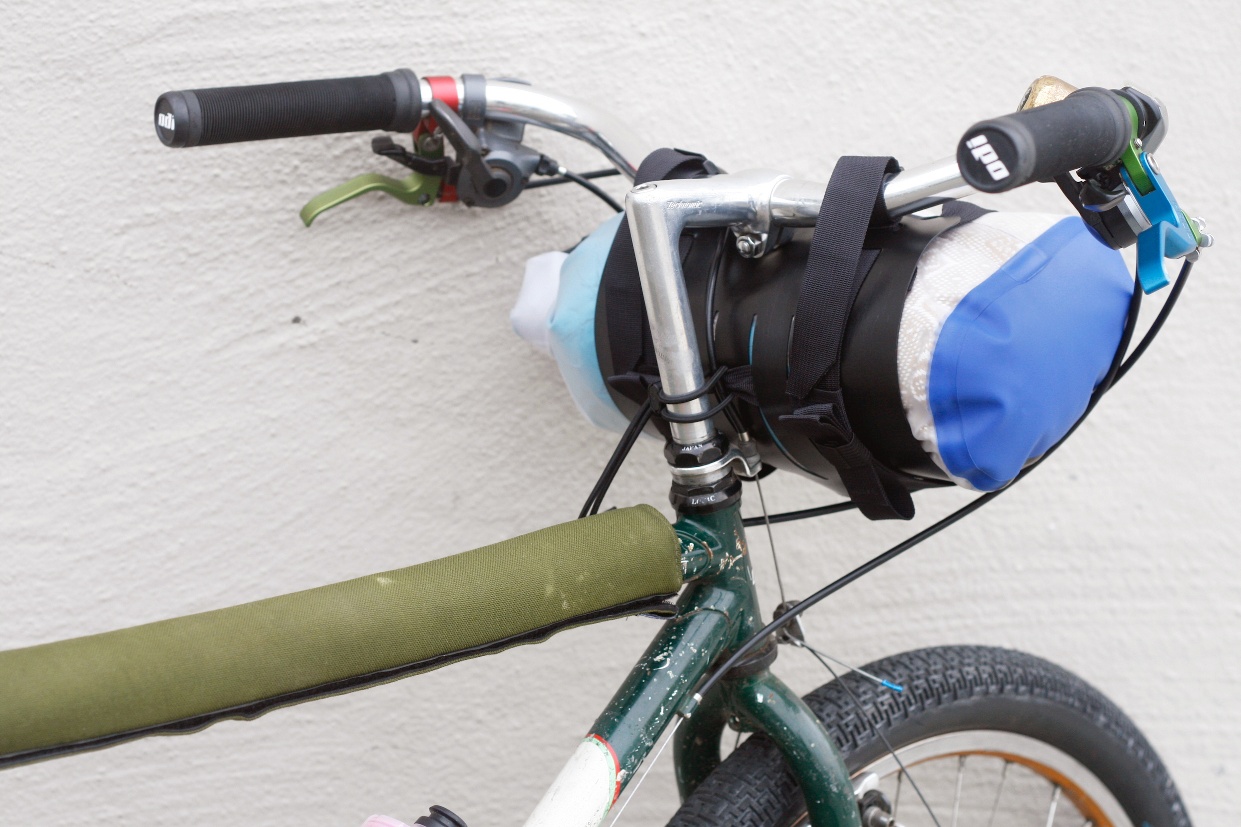 No spacers needed,5L dry bag shown, this bike doesn't fit a larger dry bag because it would run into the exposed brake cable and wouldn't fit behind the other cables