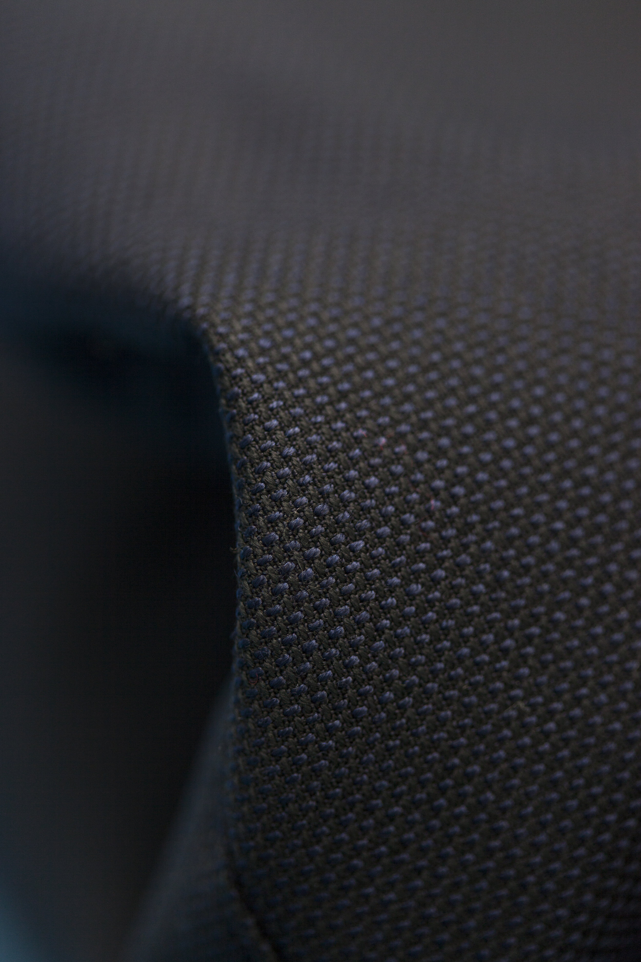 Super100 wool fabric with a technical membrane on the backside called warmsense. Warmsense reacts to UV rays and warms up the fabric (up to 3°C) in cold sunny days. The fabricis also breathable and water resistant. The wool from the fabric supplier Reda is ZQ certified, and is pure Merino wool from sheep reared on their own farms in New Zealand. It relies on a vertically integrated process totally controlled and guided by the principle of sustainability in a system of eco-management. It is also the only wool mill in the world that holds the EMAS (Eco Management and Audit Scheme) environmental certification. This is a European Union initiative designed to monitor and improve companies' environmental performance. Used on style Million Coat.